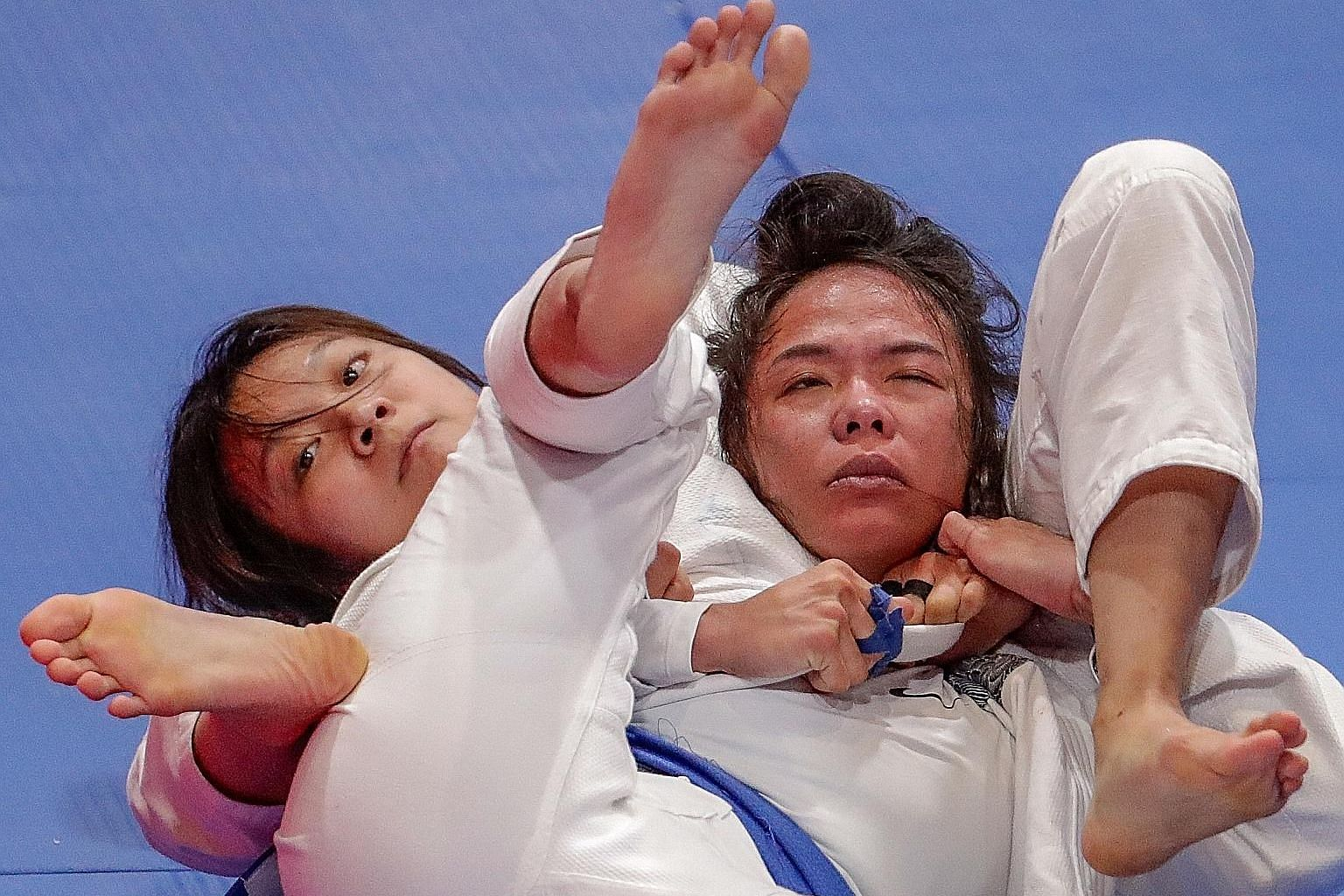 Constance Lien made an early sweep before finishing off Vietnam's Nguyen Ngoc Tu with a submission choke in the jiu-jitsu Under-62kg final. PHOTO: SNOC