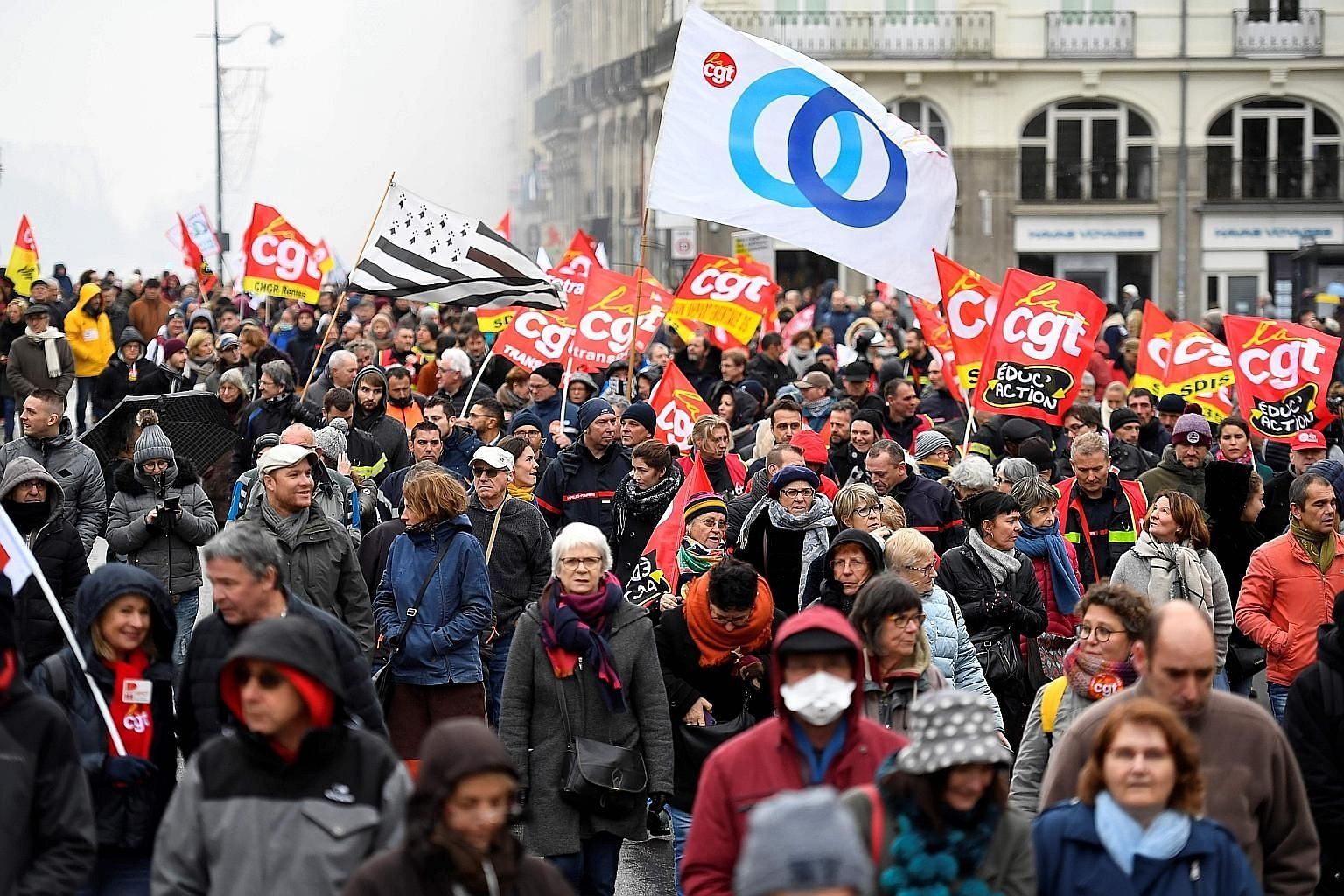 A demonstration by French public-sector workers in Rennes yesterday, the sixth day of massive strike action across the country over plans by the government to overhaul the pension system. PHOTO: AGENCE FRANCE-PRESSE