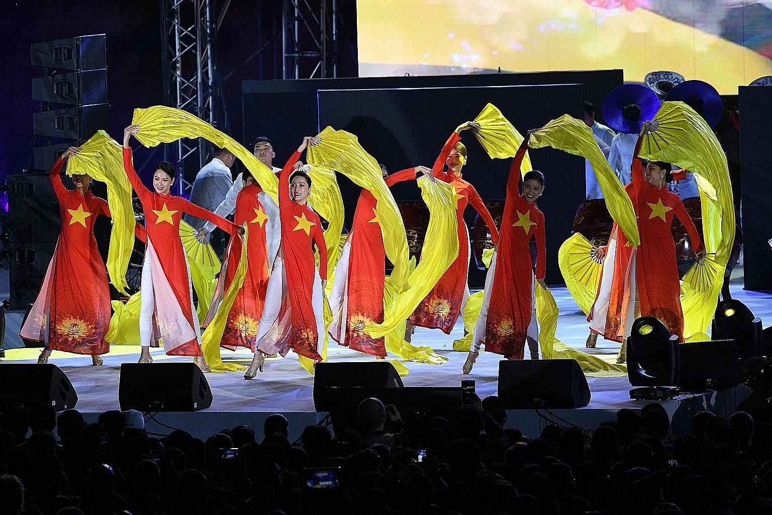 Performers from Vietnam, the next host, at the SEA Games closing ceremony in Clark, north of Manila, yesterday. PHOTO: AGENCE FRANCE-PRESSE