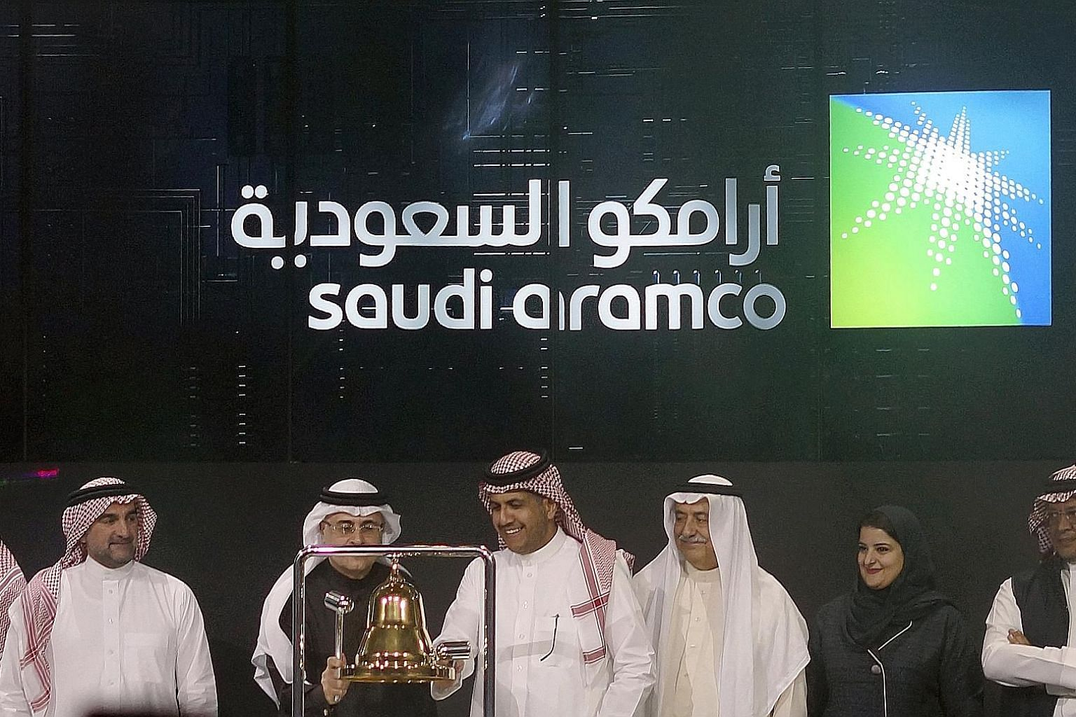 Saudi Arabia's state-owned oil giant Saudi Aramco and stock market officials at the official ceremony marking the debut of Aramco's initial public offering (IPO) on the Riyadh stock market yesterday. The Aramco shares leapt to 35.2 riyals (S$12.76) e