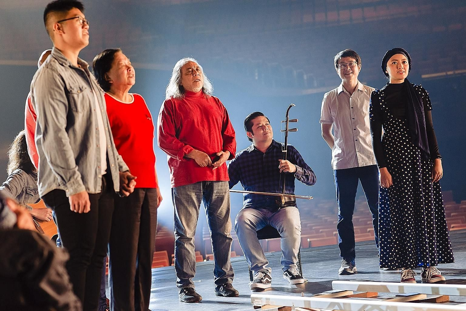 Veteran singer-songwriter Ramli Sarip (centre, in red) singing in a music video to mark Majulah Singapura's 60th anniversary as the National Anthem. Mr Ramli's version was sung at this year's National Day Parade.
