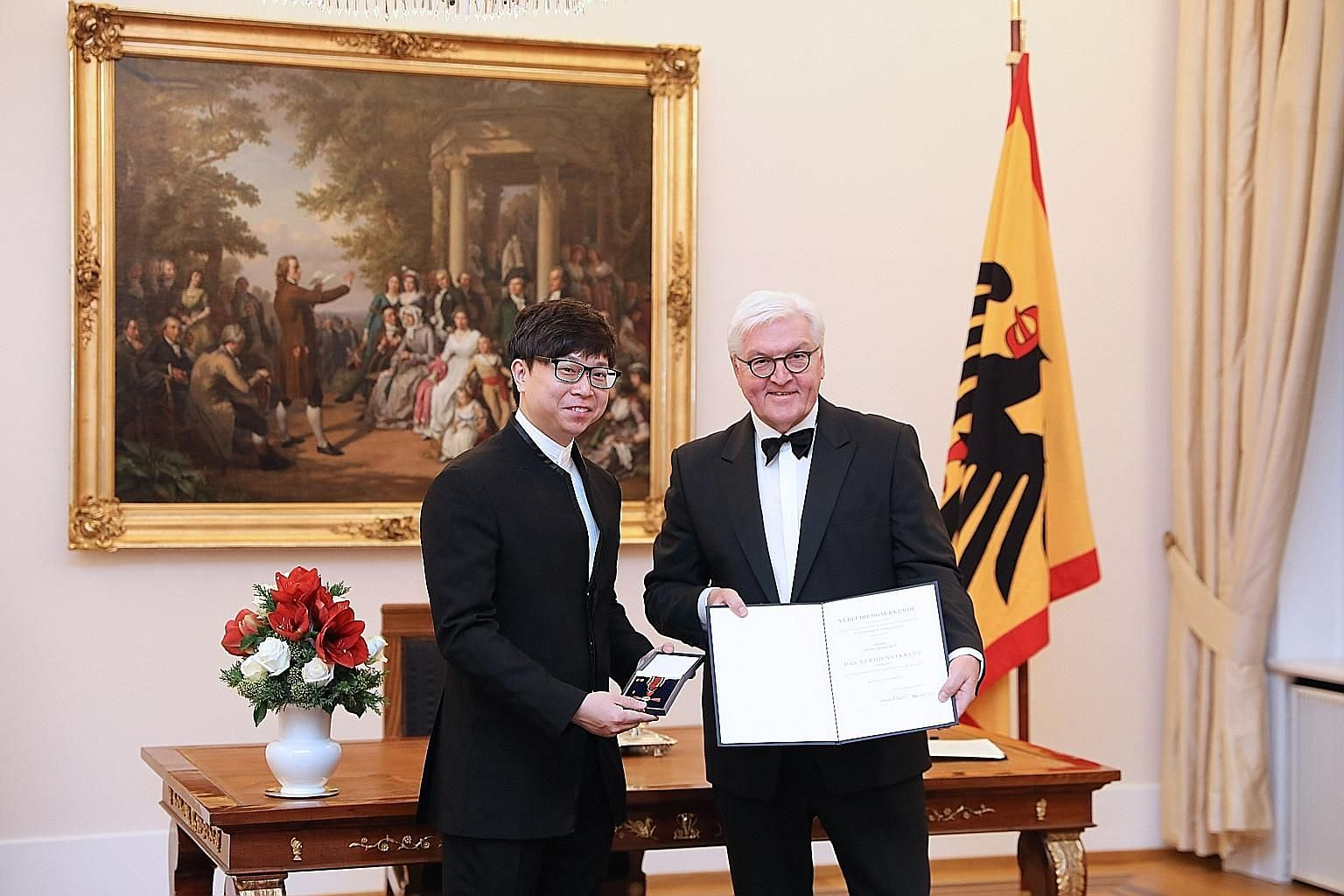 Singaporean conductor Wong Kah Chun receiving the Order of Merit of the Federal Republic of Germany from German President Frank-Walter Steinmeier at a state banquet on Tuesday.