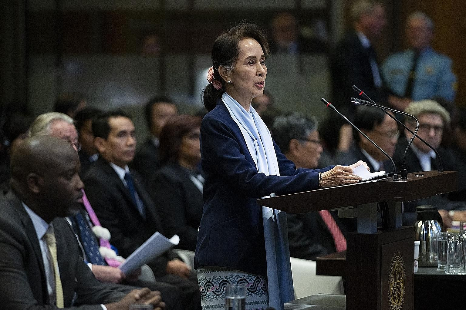 Myanmar's de facto leader Aung San Suu Kyi addressing judges of the International Court of Justice as Gambia's Justice Minister Abubacarr Tambadou (left) listened, on the second day of three days of hearings in The Hague. Gambia had brought the case