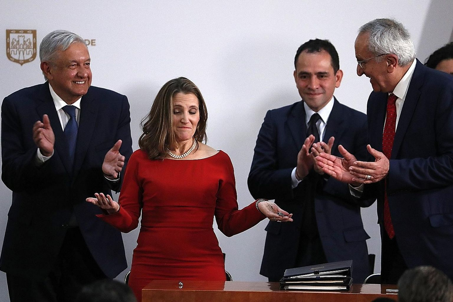 (From left) Mexican President Andres Manuel Lopez Obrador, Canadian Deputy Prime Minister Chrystia Freeland, Mexican Treasury Secretary Arturo Herrera and Mexico's top trade negotiator Jesus Seade after signing the revamped US-Mexico-Canada Agreement
