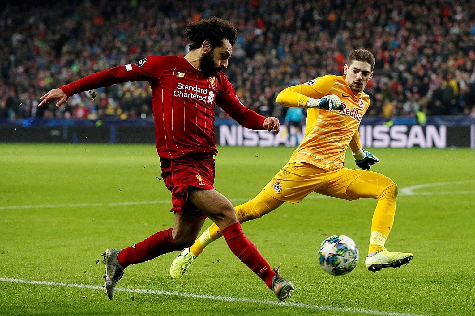 Having missed a host of easy chances, Mohamed Salah got the breakthrough with a neat finish from a tight angle for Liverpool's second goal. The 2-0 win over Salzburg on Tuesday ensured top place in Group E of the Champions League for the Reds, ahead