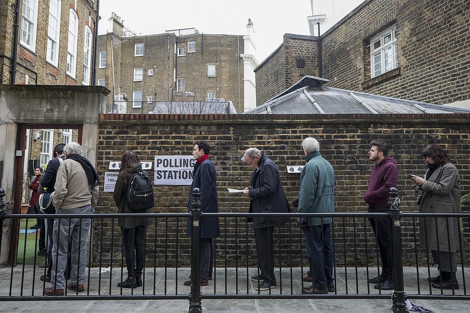 Voters queueing to enter a polling station in London. More than 4,000 polling venues across England, Scotland, Wales and Northern Ireland opened their doors yesterday for an election seen as one of the most important since the end of World War II.