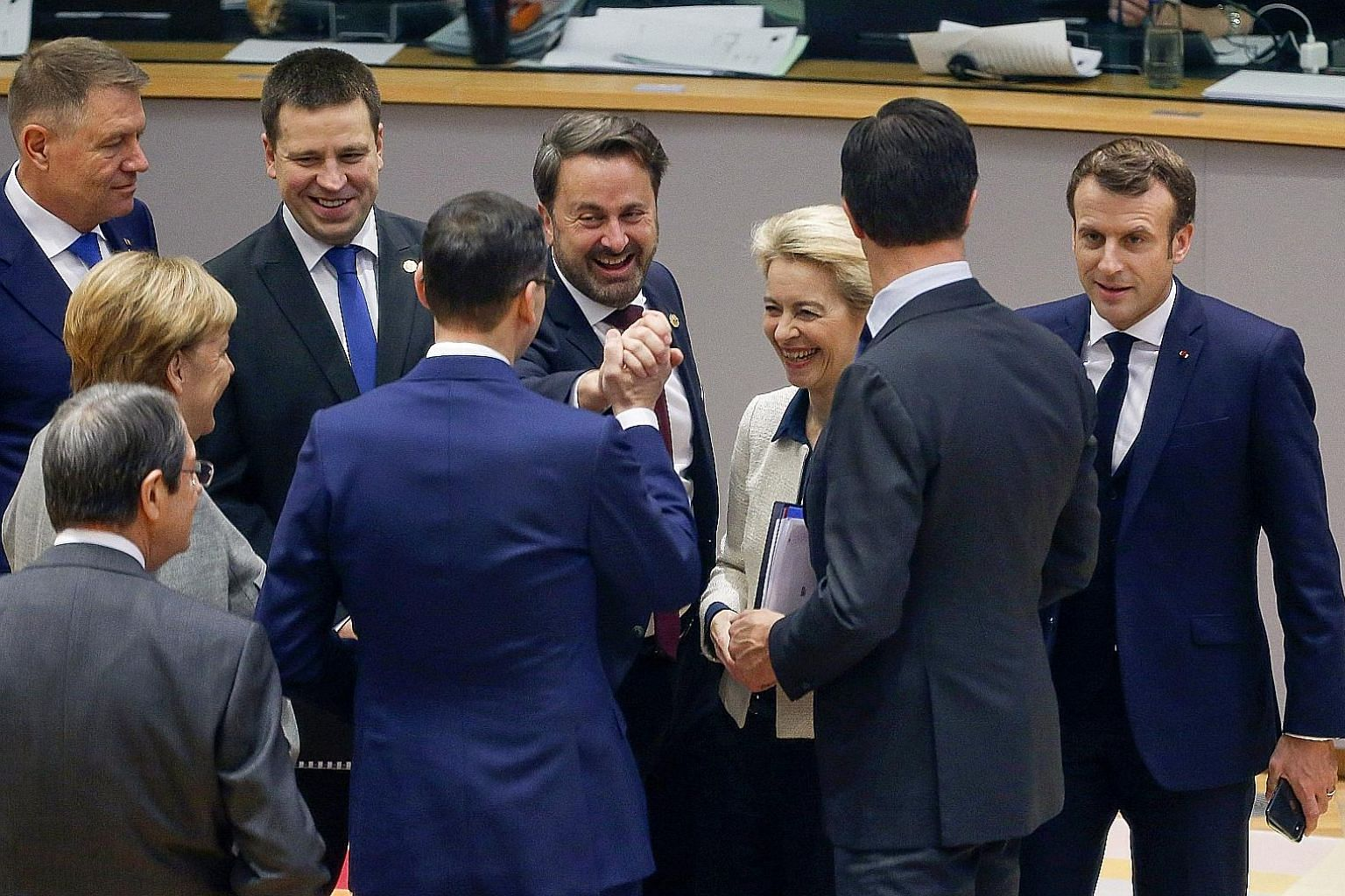 European Union leaders meeting at an EU summit in Brussels yesterday. They welcomed British Prime Minister Boris Johnson's election win in Britain, saying it would end months of political gridlock over Brexit. German Chancellor Angela Merkel said Mr