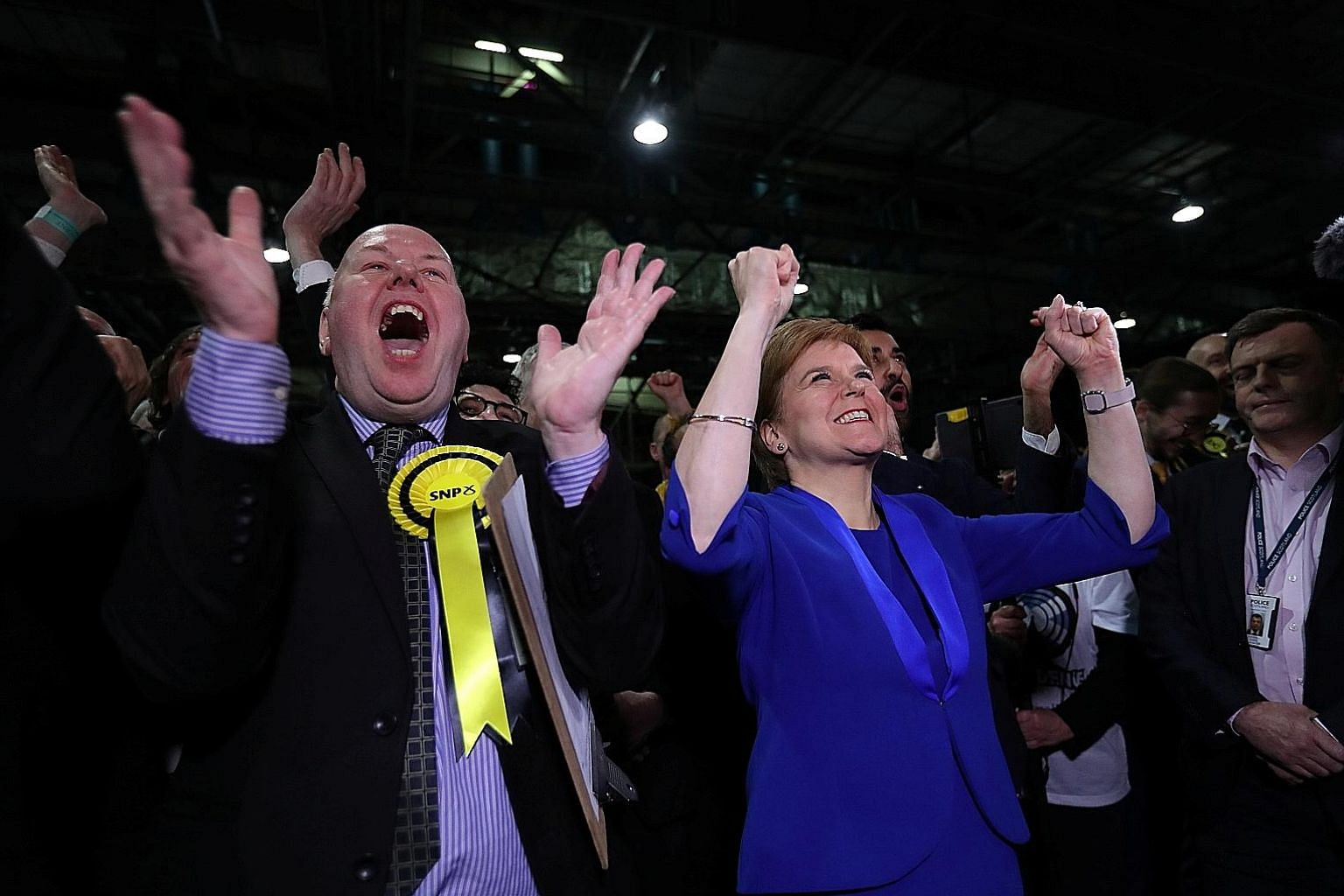 Scottish National Party leader Nicola Sturgeon cheering with supporters at a counting centre for the general election in Glasgow, Scotland, yesterday. Scottish nationalists won 48 of the 59 parliamentary seats in Scotland.