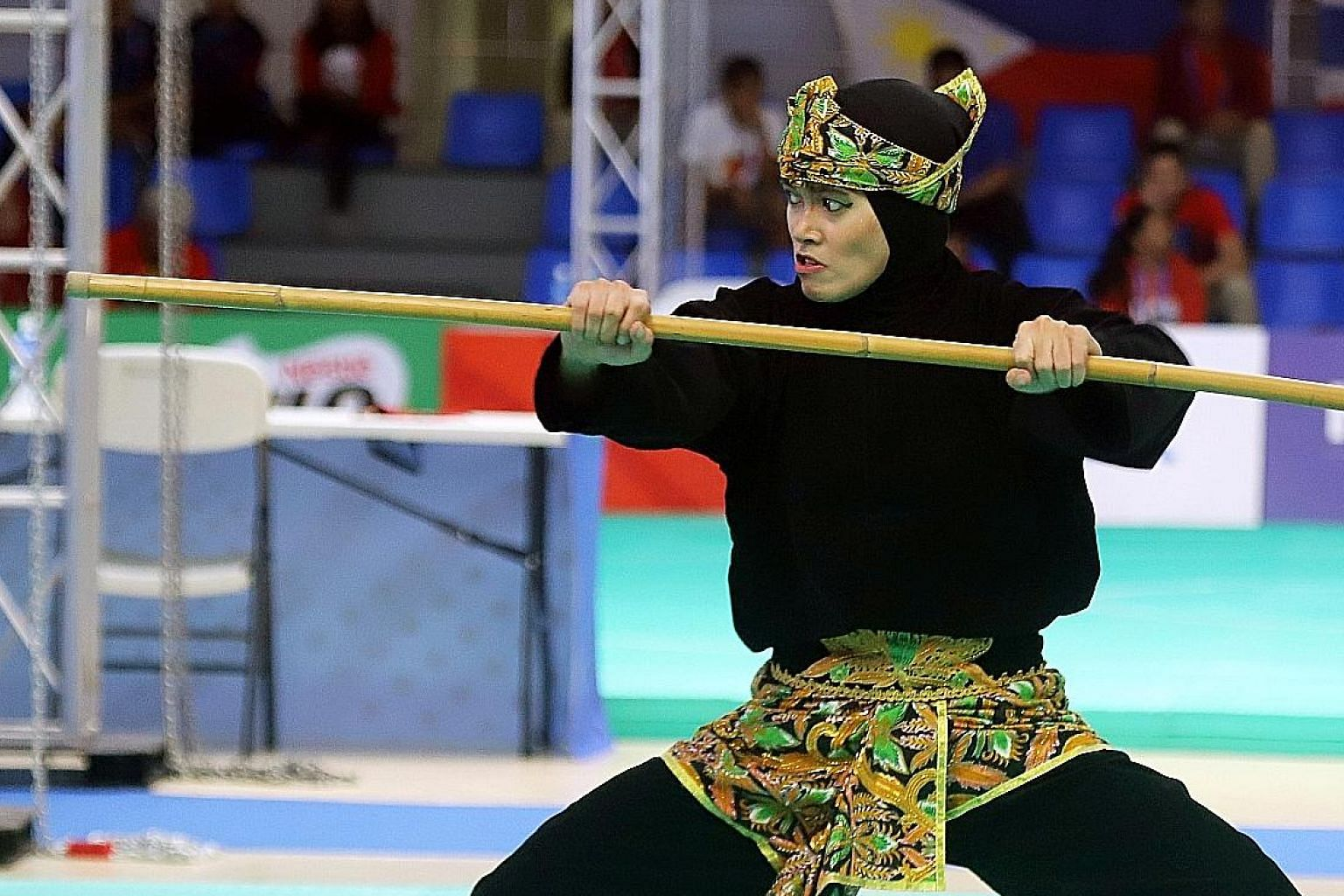 """Indonesia's Puspa Arum Sari competing last week in a women's pencak silat event at the SEA Games held in the Philippines. Unesco says the sport contains """"mental-spiritual, self-defence and artistic aspects""""."""