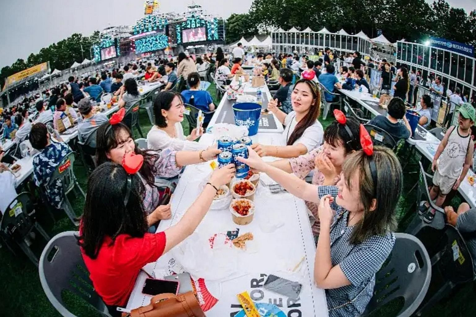 Visitors to the Daegu Chimac Festival enjoying beer and fried chicken at a park in the South Korean city of Daegu over five days in July. The event now attracts more than a million visitors yearly amid the chimaek craze. PHOTO: DAEGU CHIMAC FESTIVAL