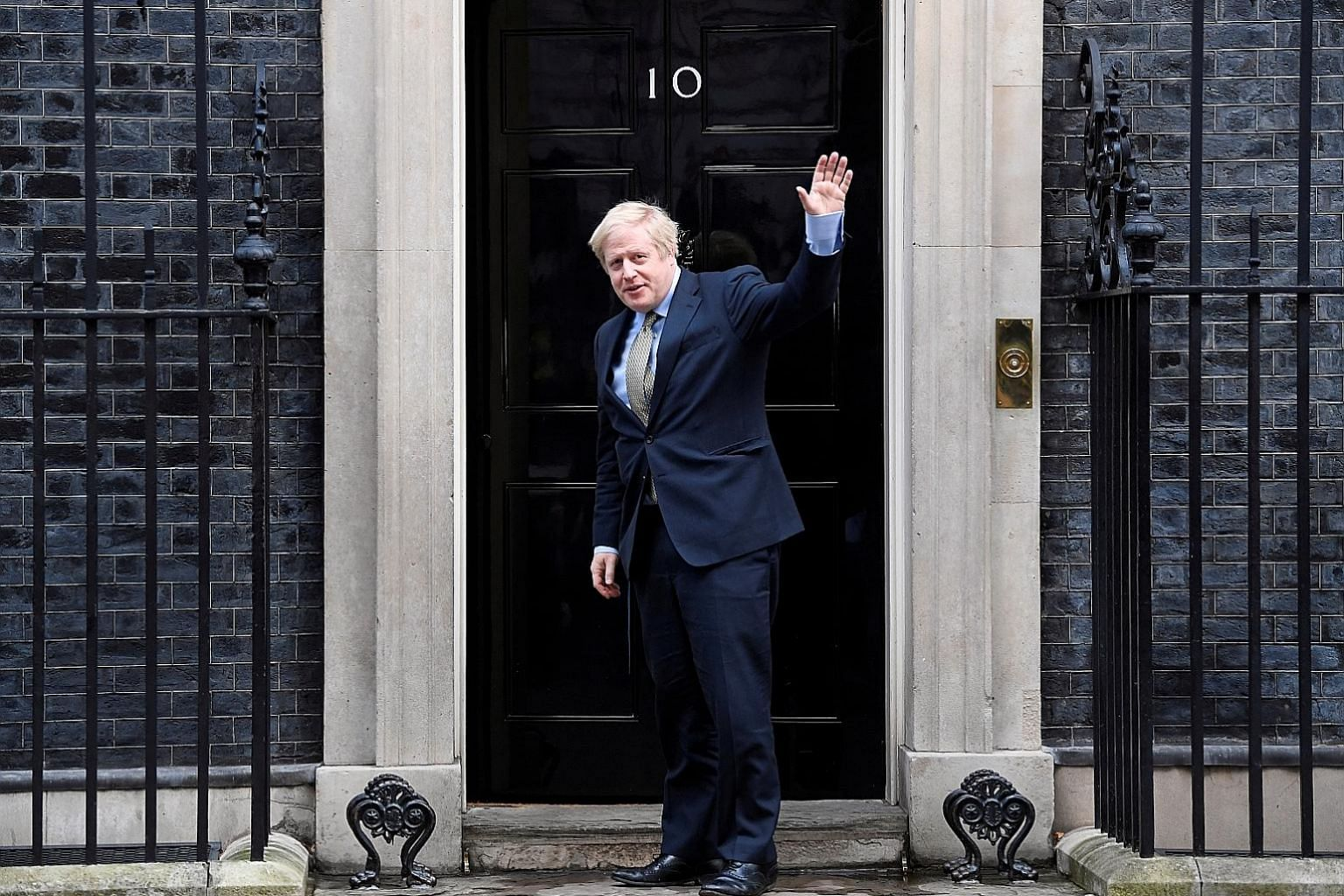 British Prime Minister Boris Johnson arriving at 10 Downing Street yesterday after meeting Queen Elizabeth at Buckingham Palace to ask for permission to form a government. The Conservatives won 365 out of 650 seats in the House of Commons.
