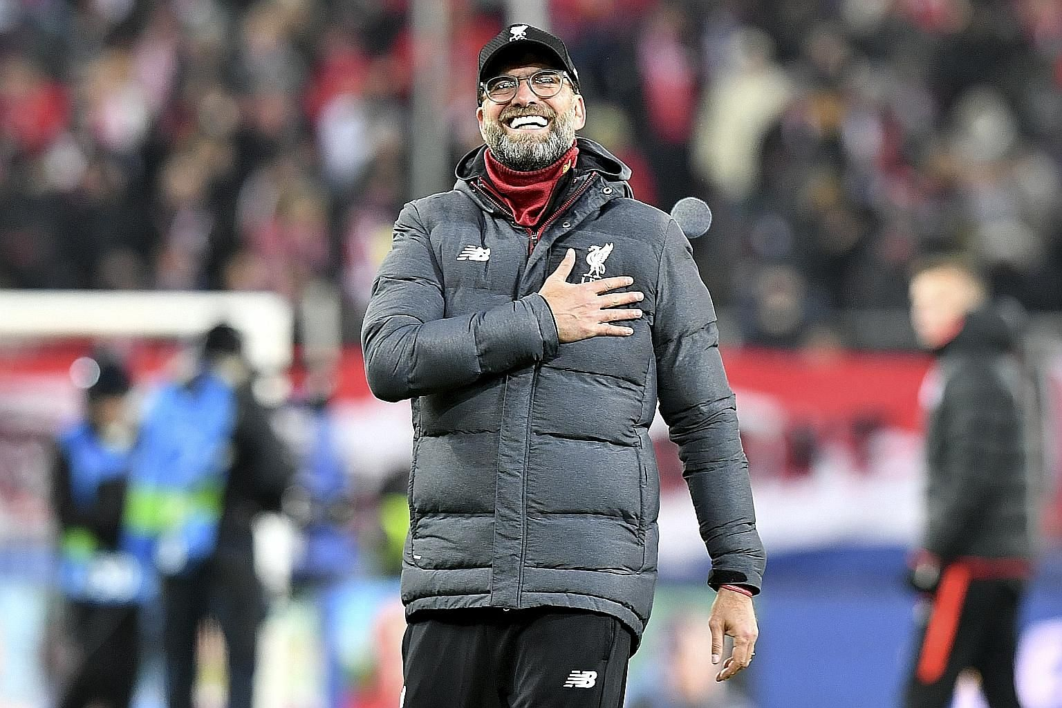 Liverpool manager Jurgen Klopp beaming at the end of their Champions League victory over hosts Salzburg on Tuesday. The Reds won 2-0 to qualify for the round of 16.