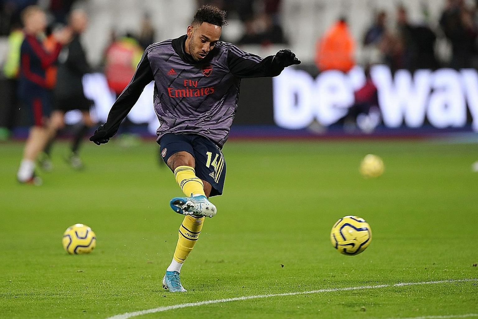Pierre-Emerick Aubameyang warming up before the Premier League match against West Ham on Monday. He scored Arsenal's final goal in their 3-1 away win and is joint second in the scoring stakes.