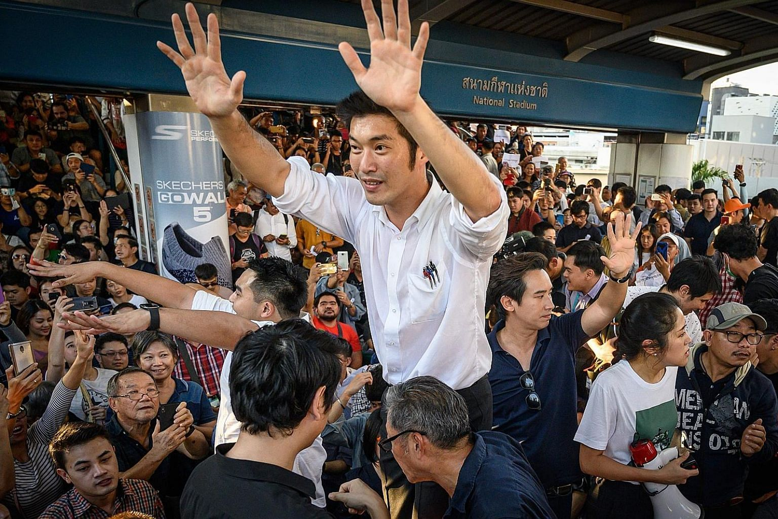 Thai Future Forward Party's leader Thanathorn Juangroongruangkit addressing his supporters during an unauthorised flash mob rally in downtown Bangkok yesterday. It revived memories of the street protests that have roiled Bangkok periodically over the