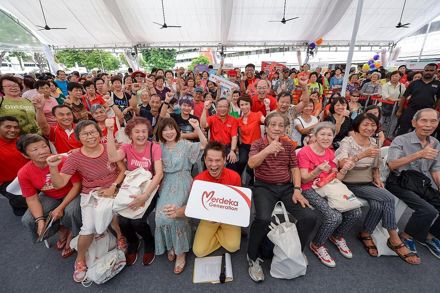 A Merdeka Generation roadshow at Bukit Gombak Neighbourhood Centre in June. Among attendees were Senior Minister of State for Health Amy Khor (first row, fourth from left) and MPs for Chua Chu Kang GRC - Health Minister Gan Kim Yong, Senior Parliamen
