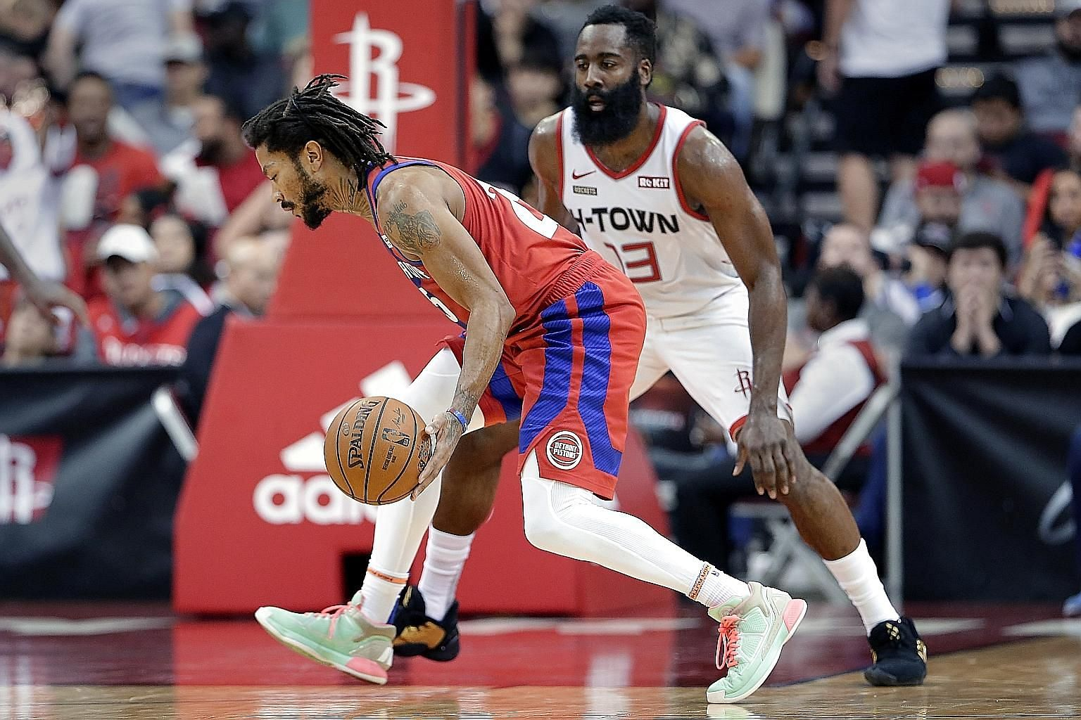Detroit's Derrick Rose driving around Houston's James Harden, as he came off the bench to score 10 of his 20 points in the final 12 minutes to help the visiting Pistons outlast the Rockets 115-107.