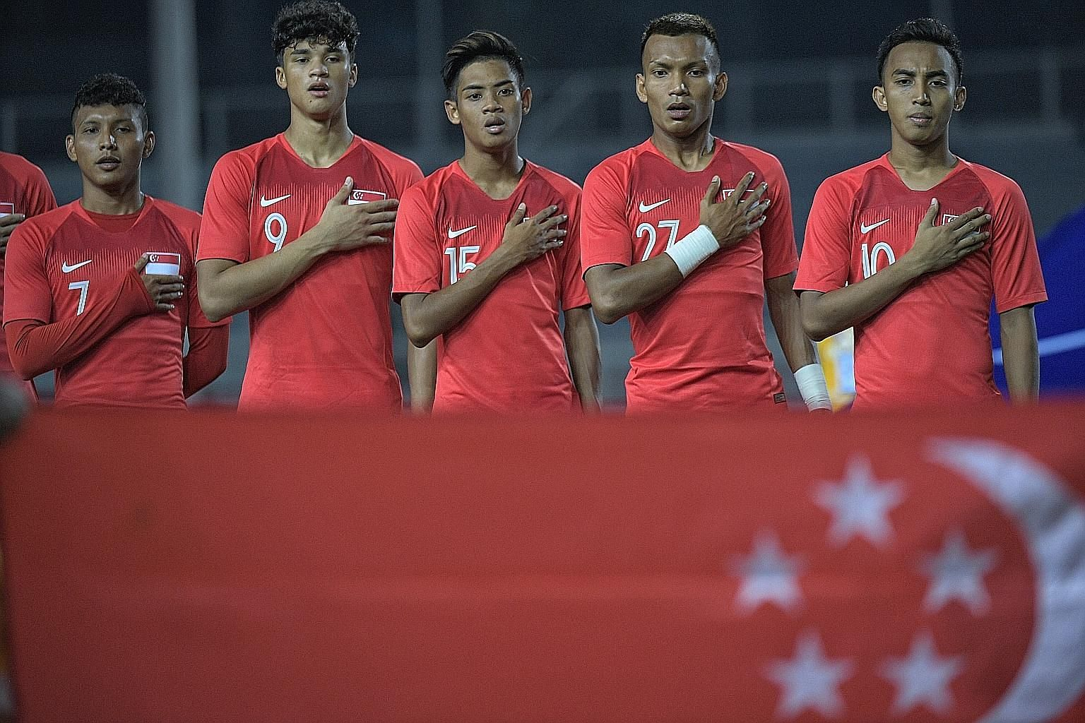 The Young Lions singing the national anthem before their SEA Games opener against Laos in Manila last month. Nearly half the squad broke curfew before the event ended. ST PHOTO: MARK CHEONG