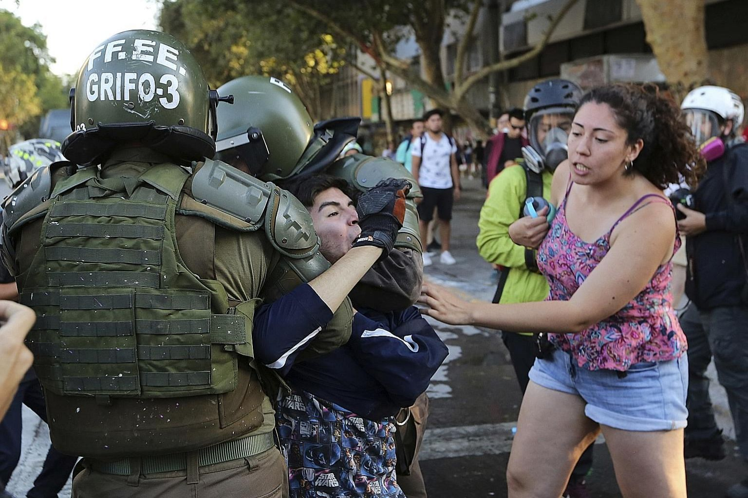 Chilean police arresting an anti-government demonstrator in the capital Santiago on Monday. The writers say one of the myths about protest movements is that non-violent campaigns require charismatic leaders. But in Chile, Social Unity, a broad-based