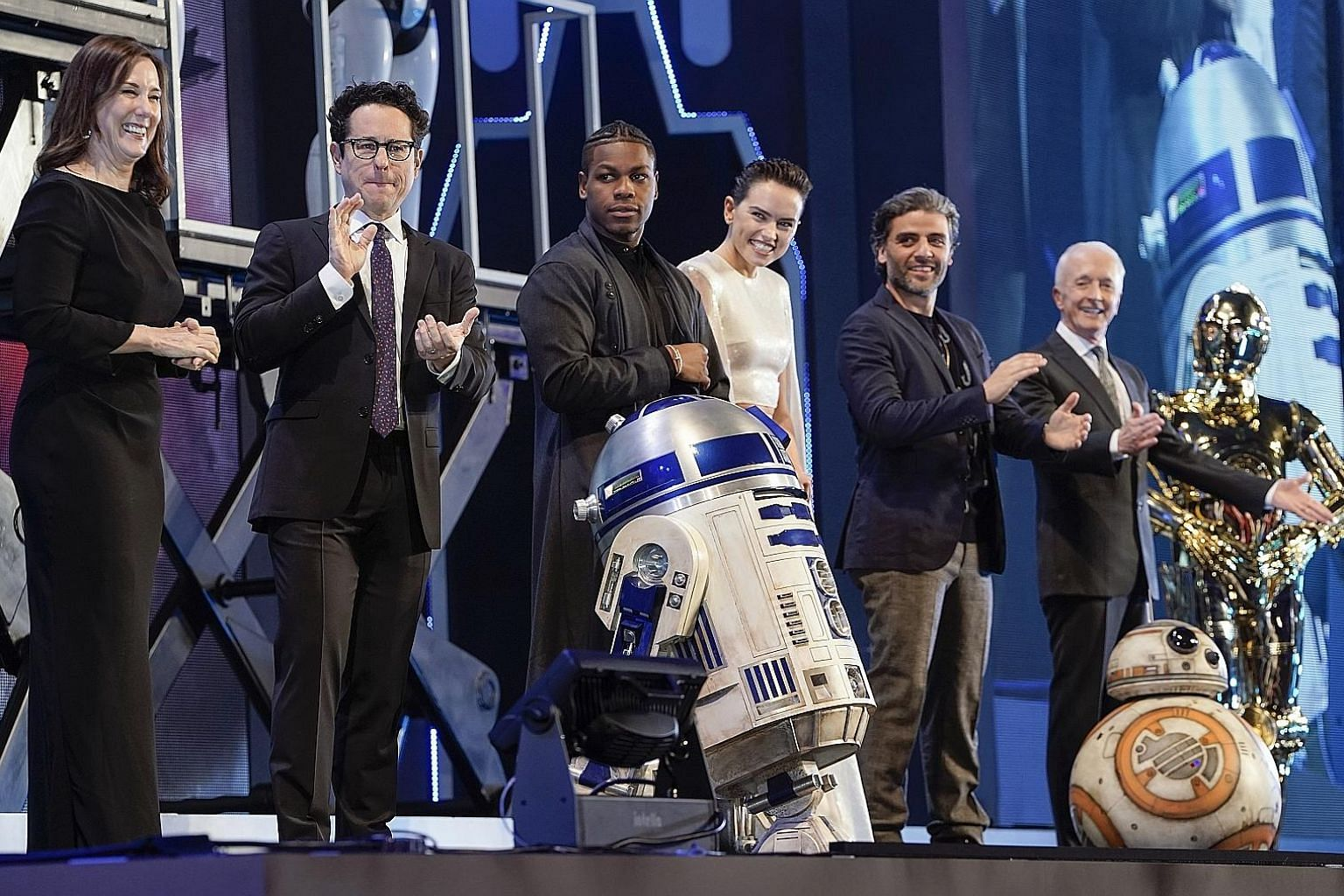 The Star Wars: The Rise Of Skywalker's cast and crew, including (above, from left) film producer Kathleen Kennedy, director J.J. Abrams and actors John Boyega, Daisy Ridley, Oscar Isaac and Anthony Daniels, in Tokyo earlier this month.