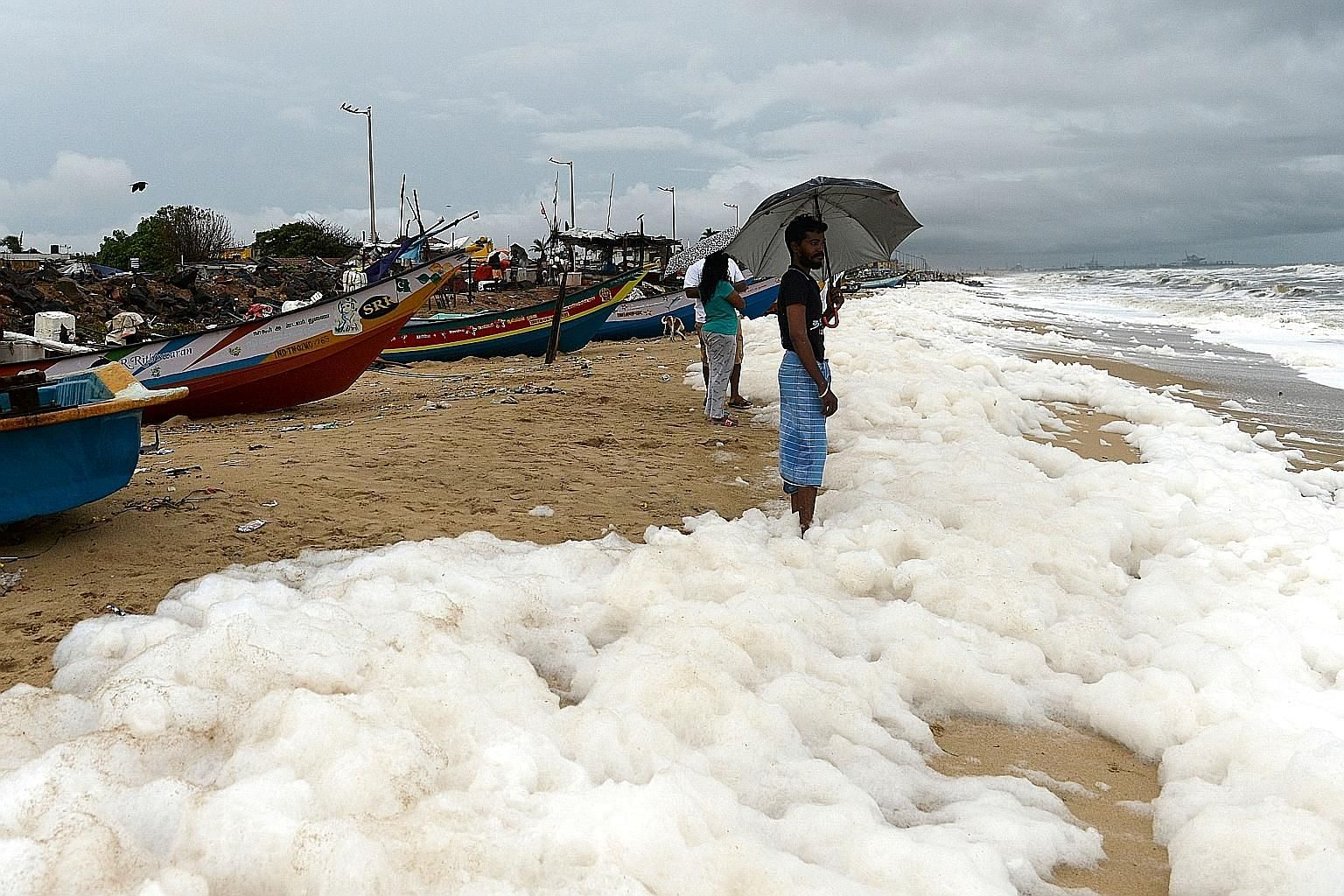 Foamy discharge, caused by pollutants, at a beach in Chennai on Dec 1. The report by the Global Alliance on Health and Pollution says India has seen increasing industrial and vehicular pollution from urban growth, while poor sanitation and contaminat