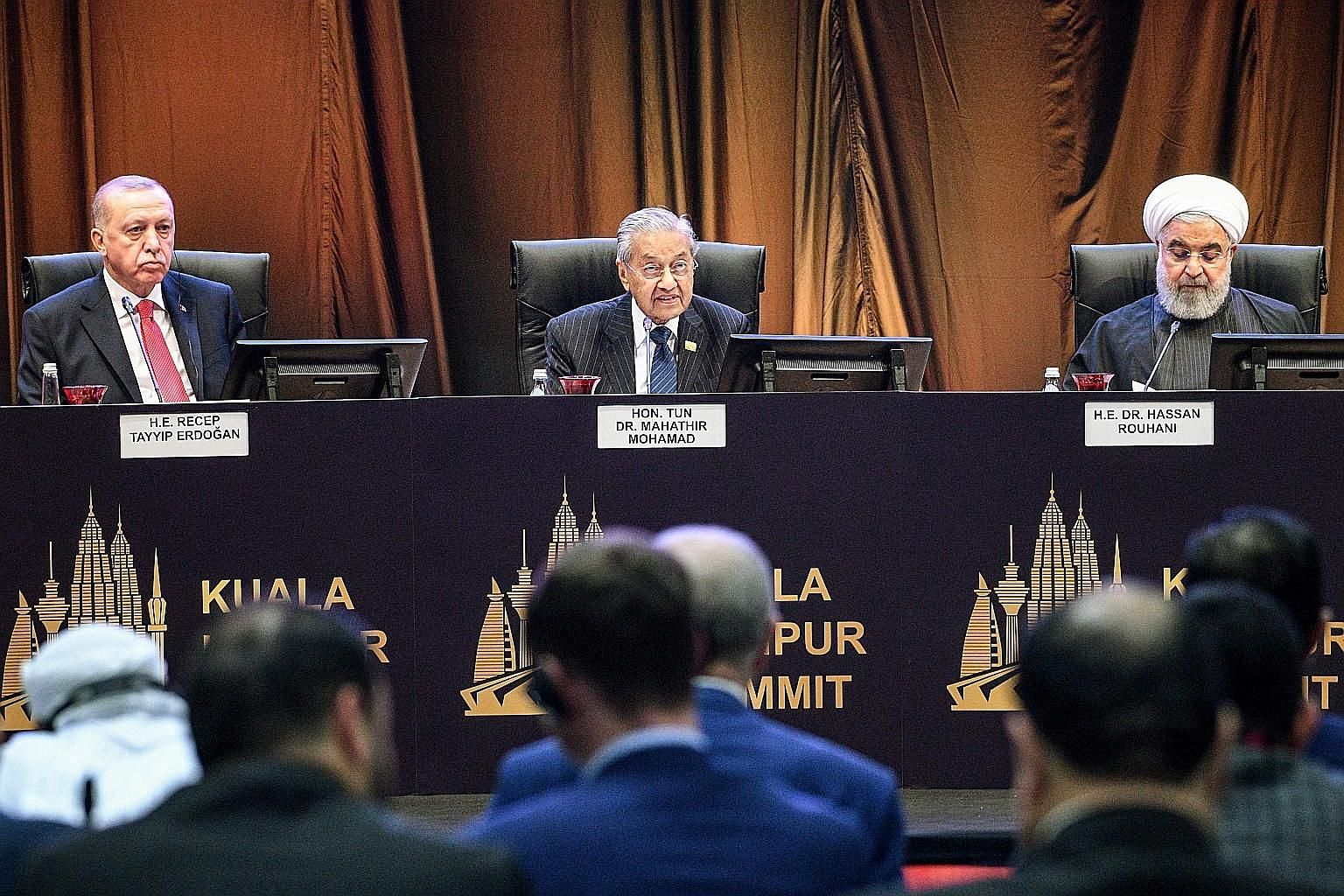 From left: Turkish President Recep Tayyip Erdogan, Malaysian Prime Minister Mahathir Mohamad and Iranian President Hassan Rouhani at the first round-table session of the Kuala Lumpur Summit yesterday.