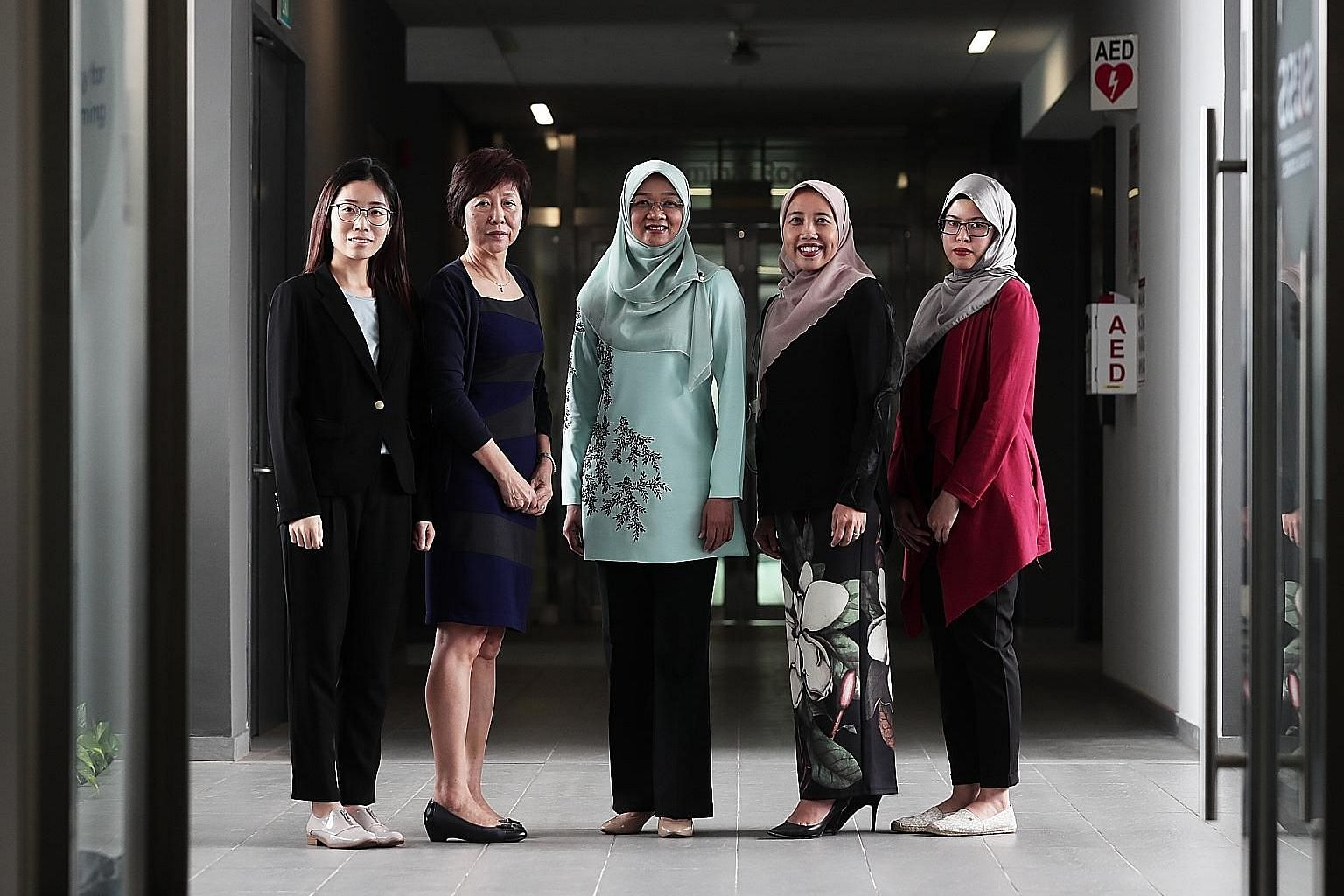 (From far left) Ms Li Jizhi, research assistant at SUSS' Business Intelligence and Analytics unit; Associate Professor Sylvia Chong, project lead of the unit; Mendaki chief executive Rahayu Buang; Mendaki deputy chief executive Aidaroyani Adam; and M