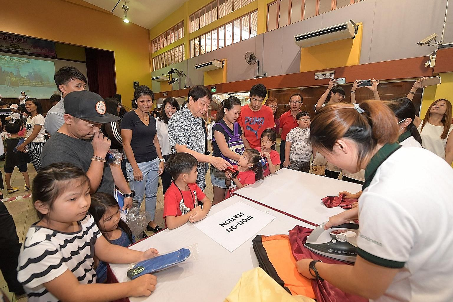 Coordinating Minister for Infrastructure and Minister for Transport Khaw Boon Wan, grassroots adviser of Sembawang GRC, attending the WeCare @ North West - Ready For School programme yesterday. About 300 students received new school bags, stationery