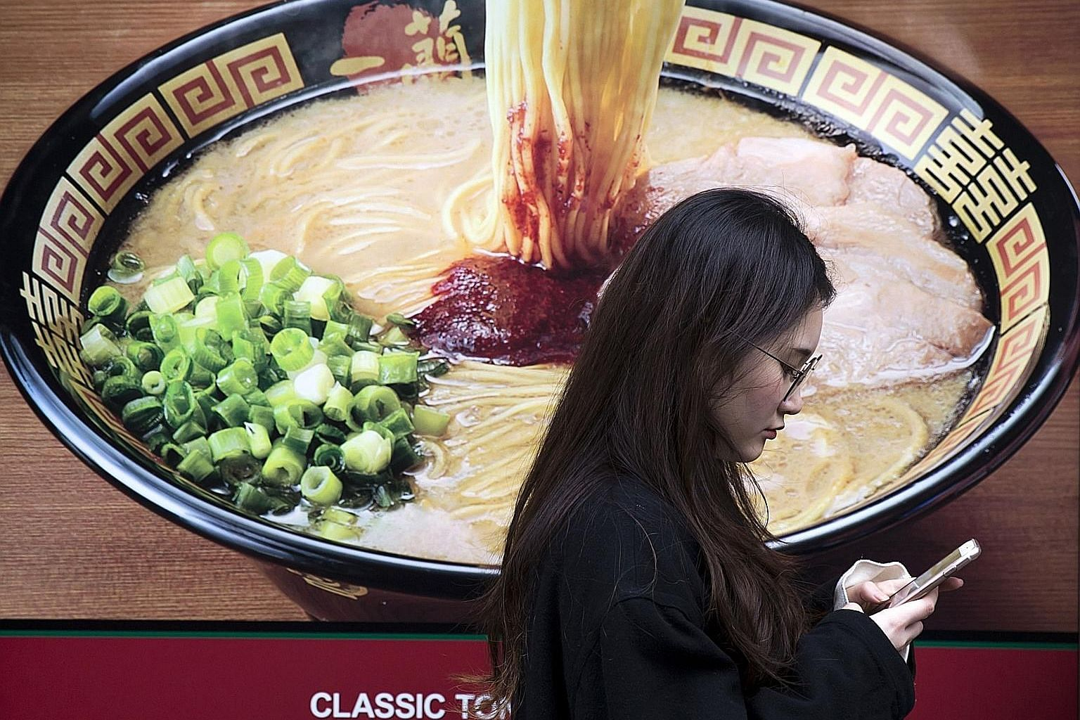 An advertisement for a ramen restaurant in Japan. A recent Japanese study notes that the popular ramen dish, being high in carbohydrates and salt, may increase the risk of stroke mortality.