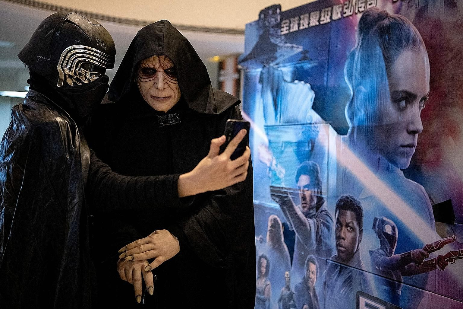 Moviegoers in Beijing dressed as Star Wars characters taking a wefie, as the latest instalment in the Skywalker saga opened worldwide this month. The writer says the success of the series has obviated a lot of its original virtues, and that much of t