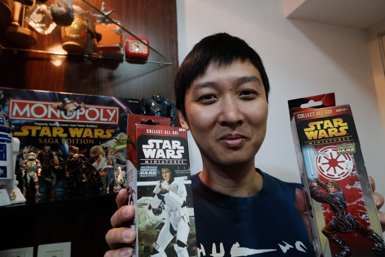Mr Chen Tao, who runs one of China's biggest online Star Wars fan groups, with Star Wars collectibles at his home in Shanghai. He is a rare superfan in the country.