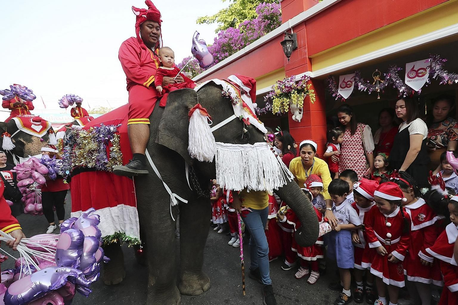 Elephants dressed as Santa Claus gave out presents and candy to pupils in Thailand yesterday in an annual Christmas tradition in the mostly Buddhist country. The Christmas celebration at Jirasartwitthaya School in Ayutthaya, north of Bangkok, has run