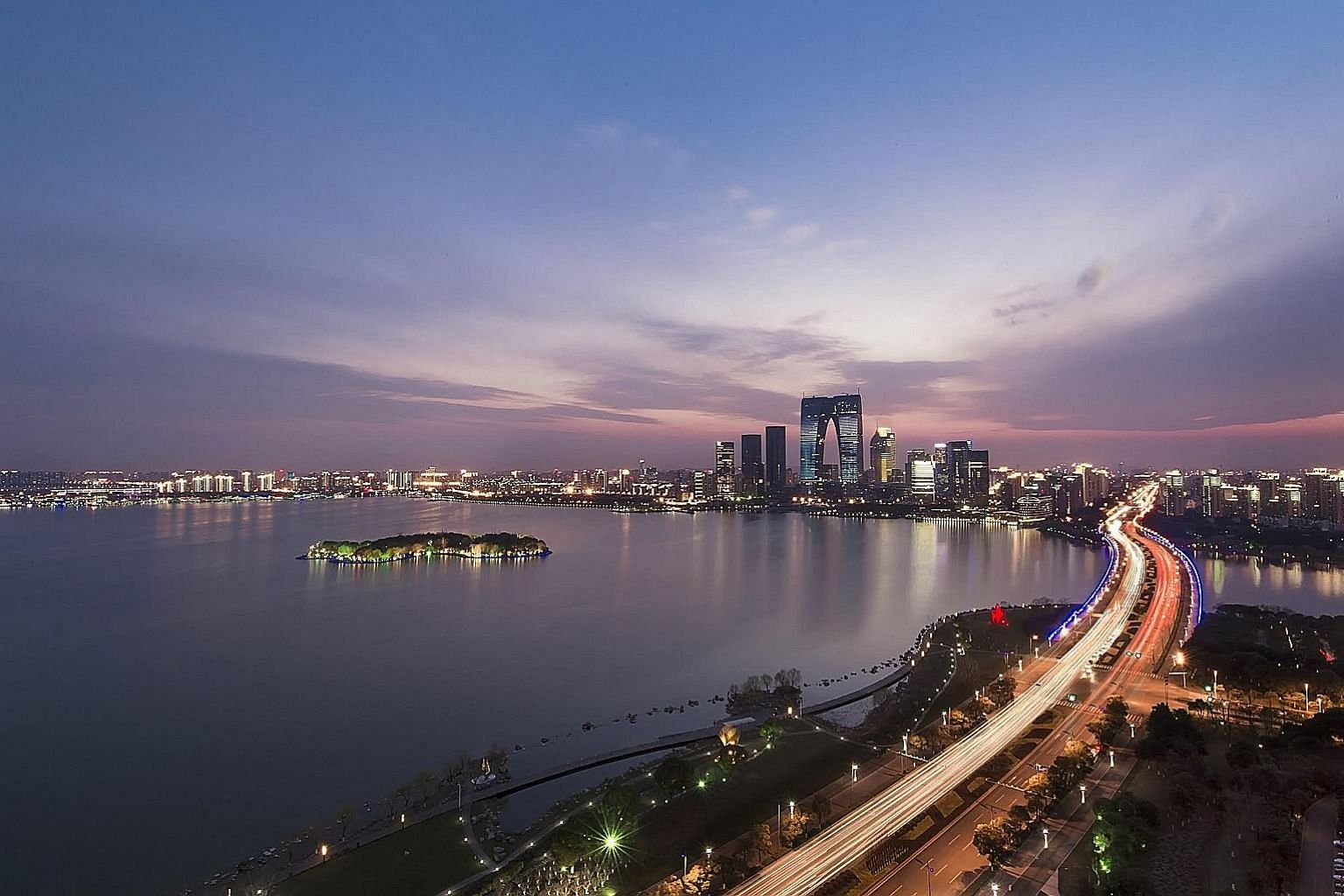 Suzhou Industrial Park started on the west bank of Jinji Lake (left) in 1994. China-Singapore SIP Development Group, the joint venture behind the project, went public last week on the Shanghai Stock Exchange, raising 1.36 billion yuan (S$263 million)