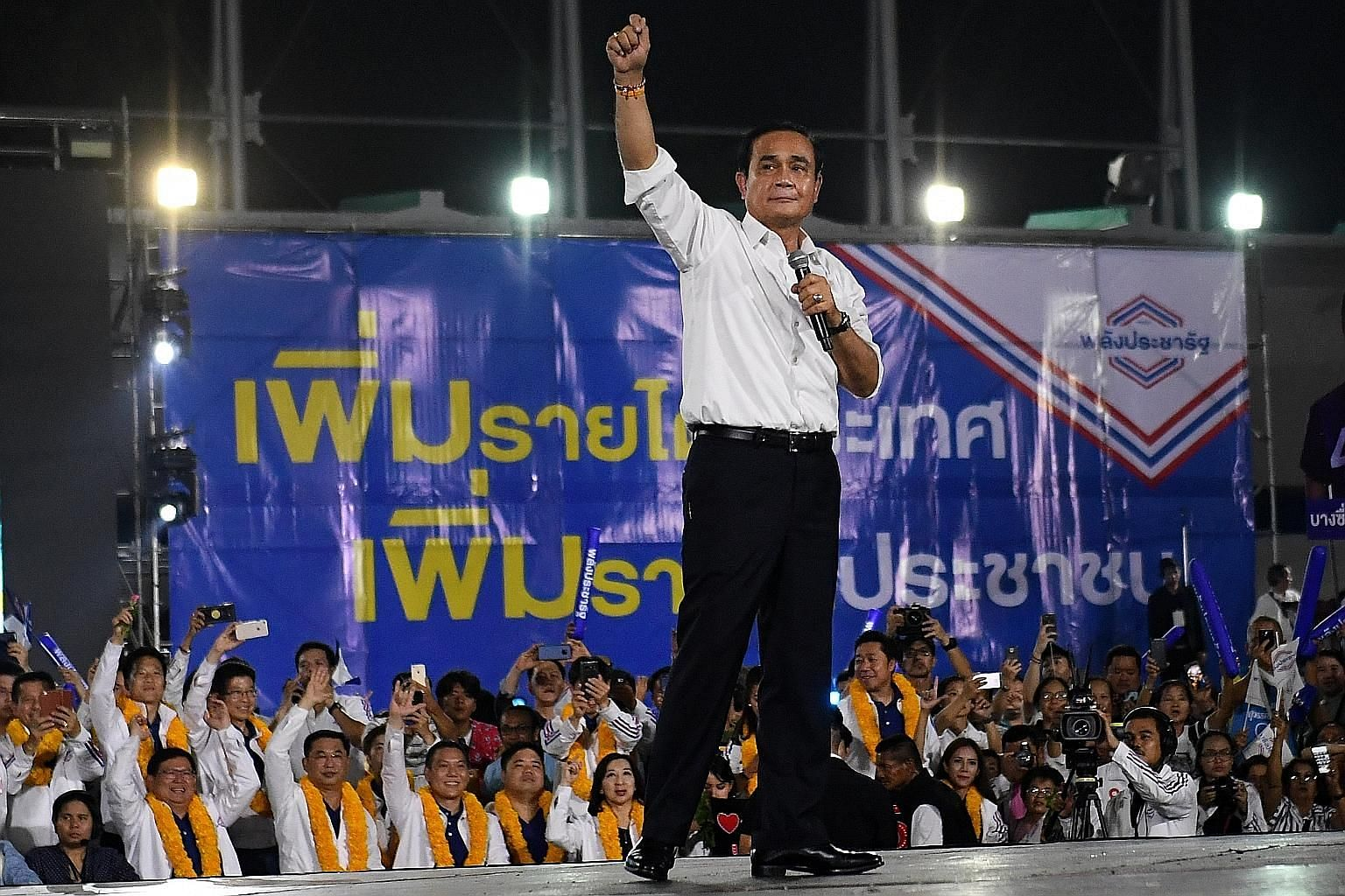 Indonesia's President Joko Widodo and Thailand's Prime Minister Prayut Chan-o-cha (above) on the campaign trail earlier this year. Both were returned to office. Mr Joko will now have to face the challenge of balancing economic growth with socio-cultural d