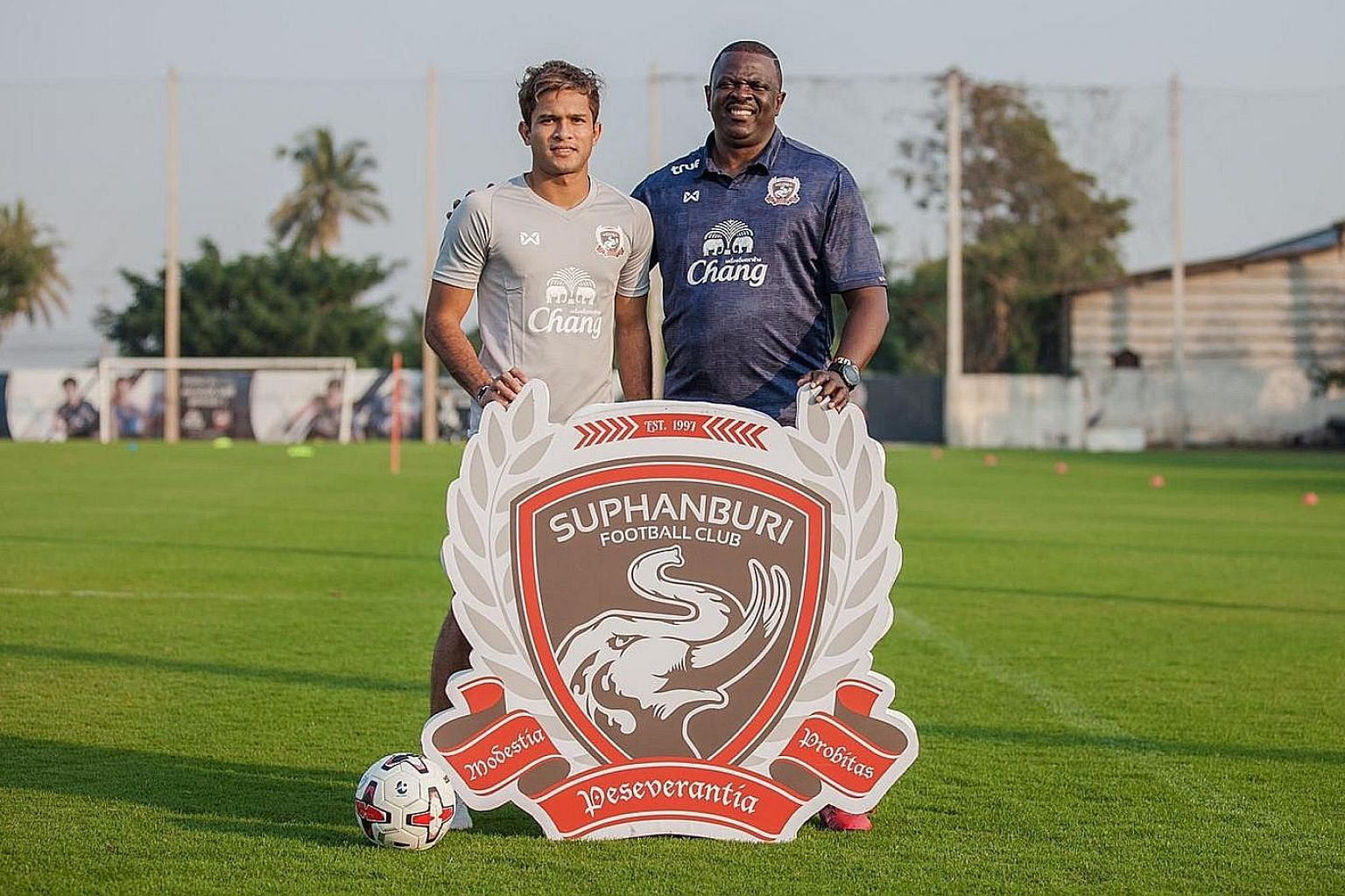Singapore midfielder Zulfahmi Arifin with his new coach Adebayo Gbadebo after signing for Thai League 1 side Suphanburi. The former Hougang captain will be the fourth Singaporean in the Thai top tier next season. PHOTO COURTESY OF SUPHANBURI FC