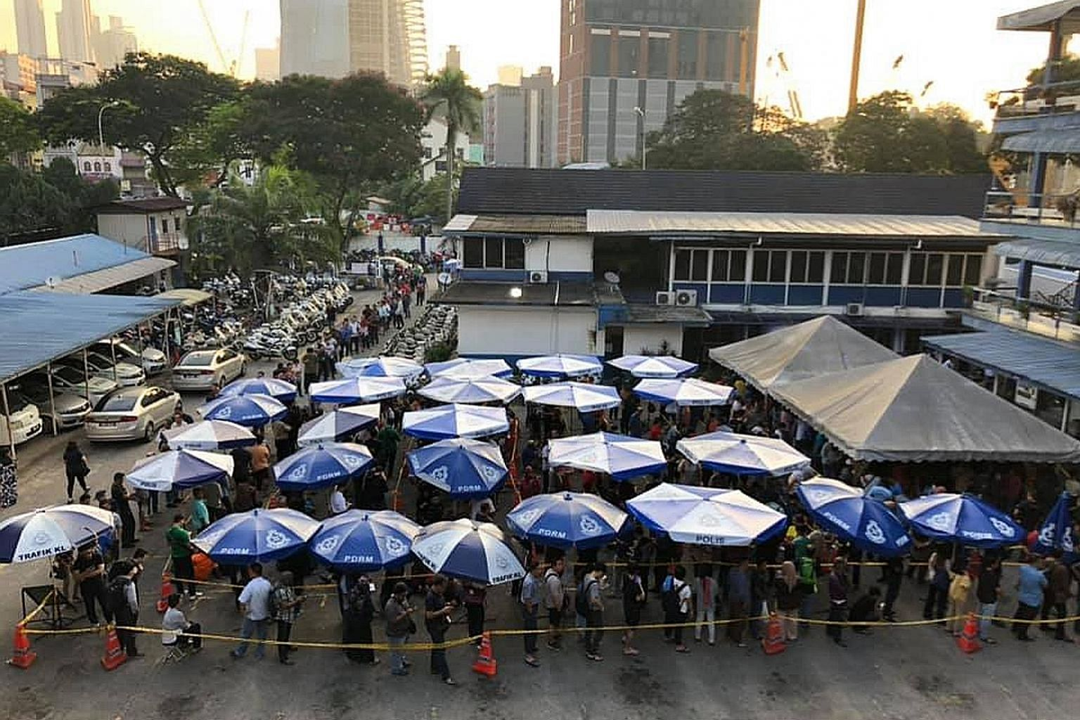 The queue to settle traffic summonses at Dataran JSPT Kuala Lumpur yesterday. Malaysian police, who periodically give steep discounts on tickets issued for traffic offences such as speeding, this year picked Christmas Eve and Boxing Day as the days f