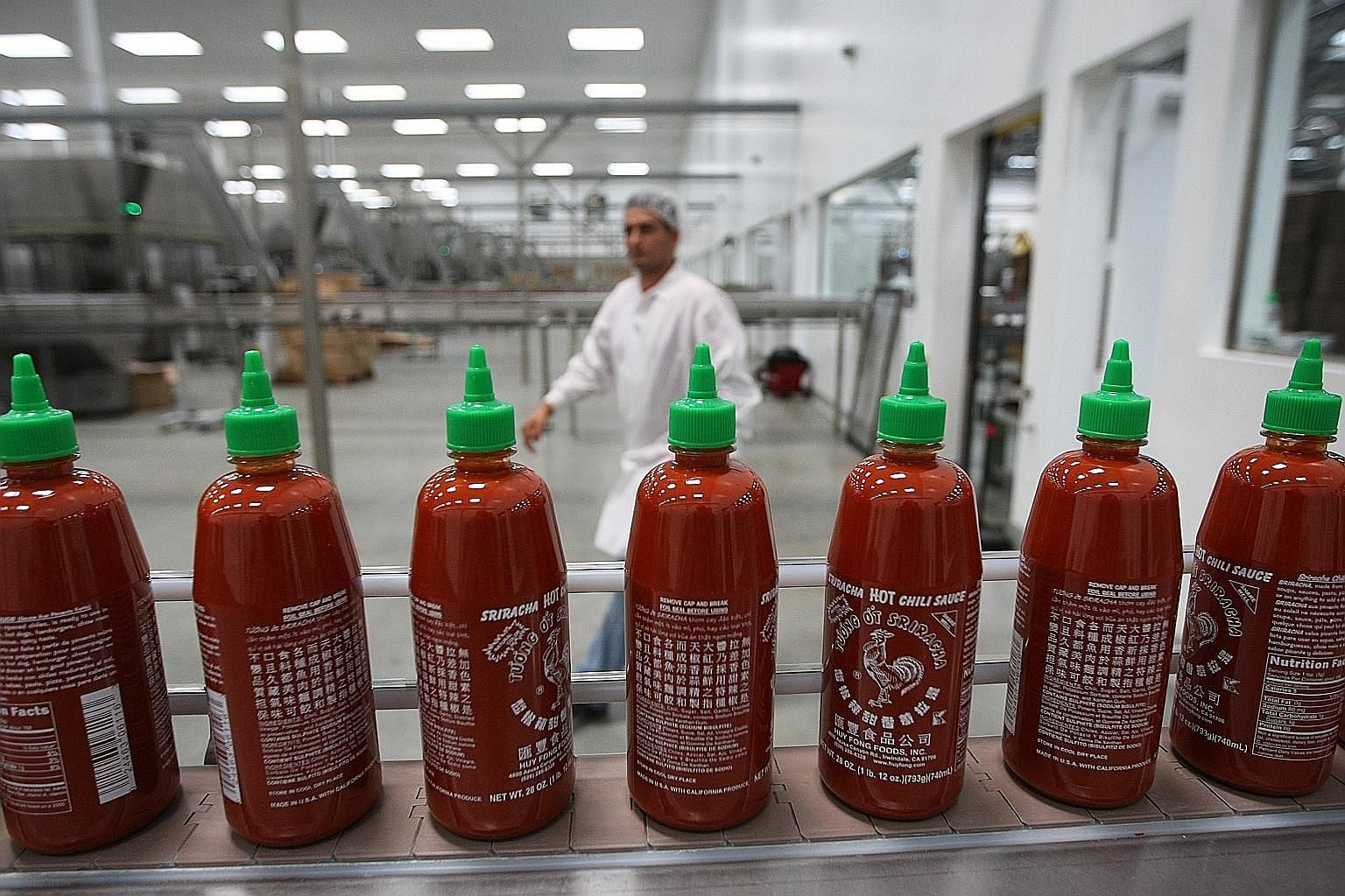 This photograph taken in 2014 shows bottles of Sriracha Hot Chilli Sauce at Huy Fong Foods' California plant.
