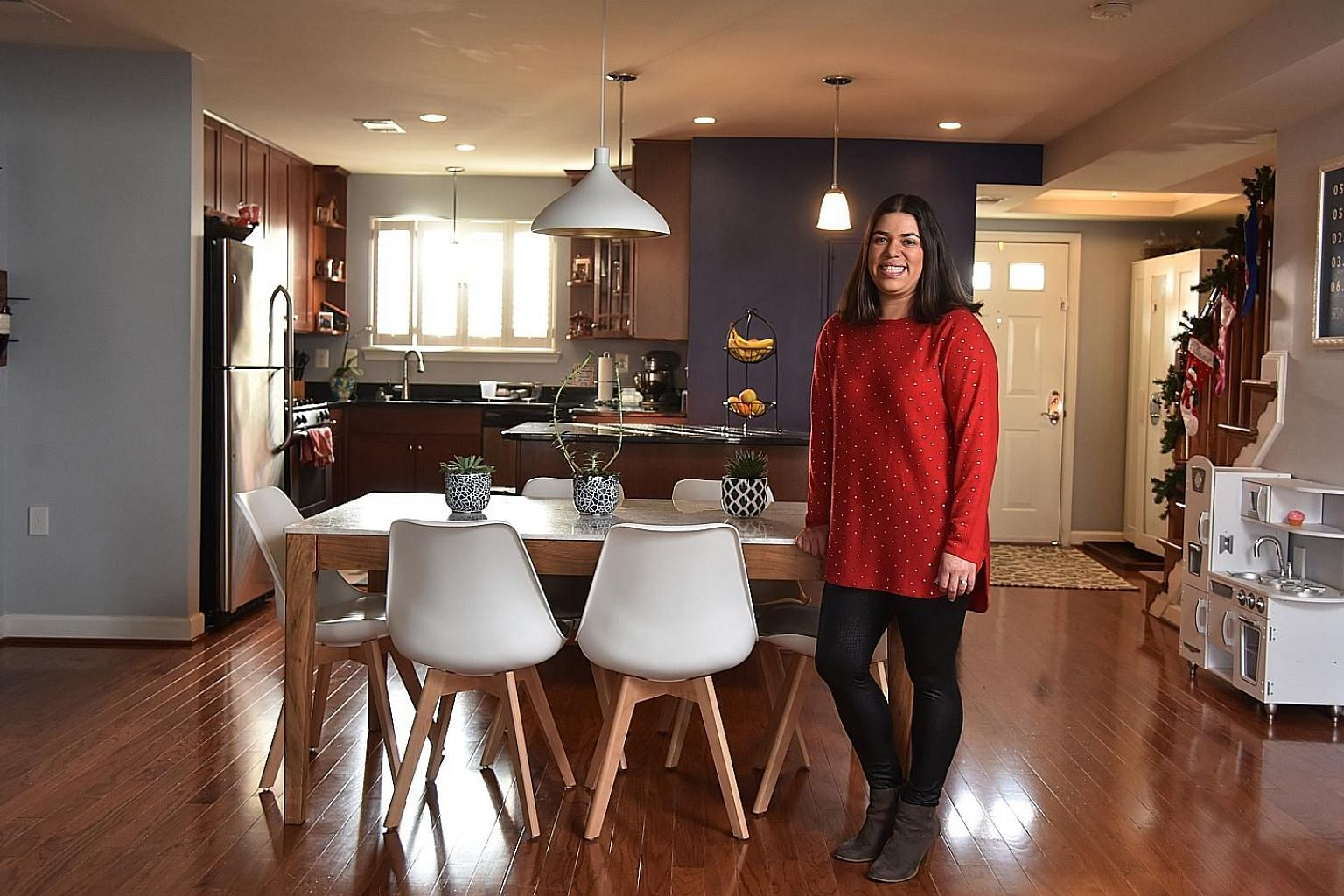 Mrs Eliana Kee in her three-bedroom, townhouse-style condominium in the Shirlington area of Arlington, Virginia.