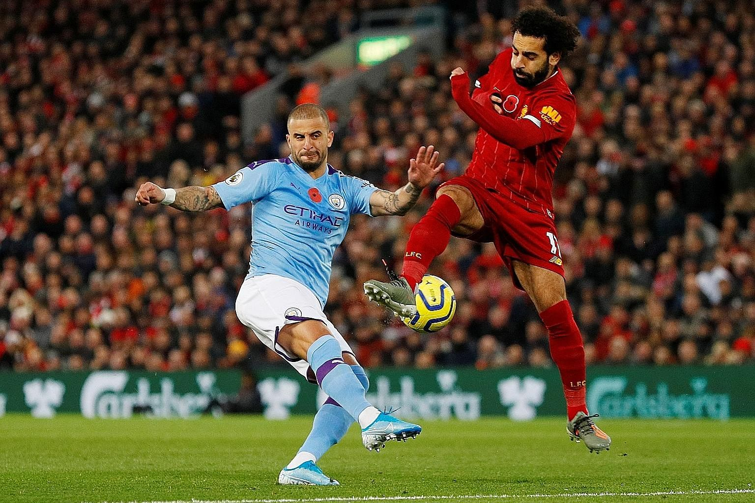 Manchester City's Kyle Walker tussling with Liverpool's Mohamed Salah at Anfield last month but the expected two-horse race between the sides has not materialised. PHOTOS: REUTERS