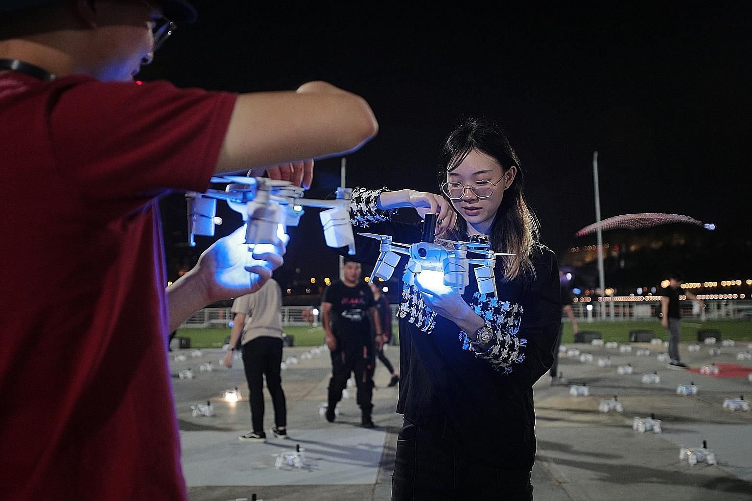 Star Island team members preparing the drones before a scheduled rehearsal at The Float @ Marina Bay last night. The aerial performance is backed by a 30-strong drone team, which includes 10 specialist pilots and engineers.