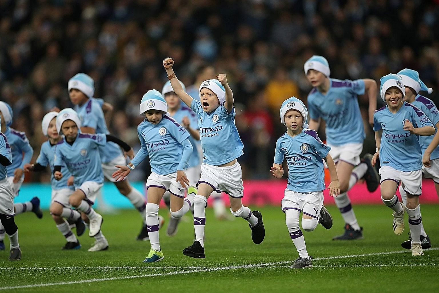 Unlike Manchester City players, the club's mascots, seen here before the Dec 21 Leicester game, were spared Friday's match at Wolves. Suitably refreshed, the mascots will reappear tonight against Sheffield United. PHOTO: REUTERS
