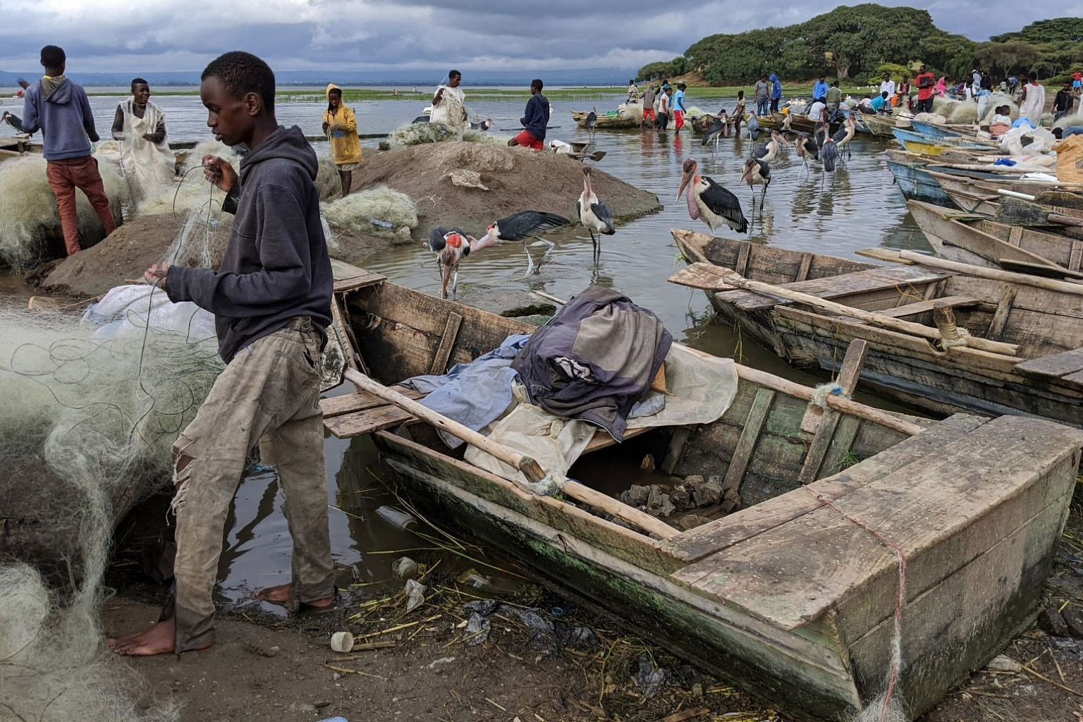 On the shore of Lake Hawassa, fishermen pull in their catch, untangle their nets and hawk their tilapia and catfish as marabou storks and pelicans lurk around.