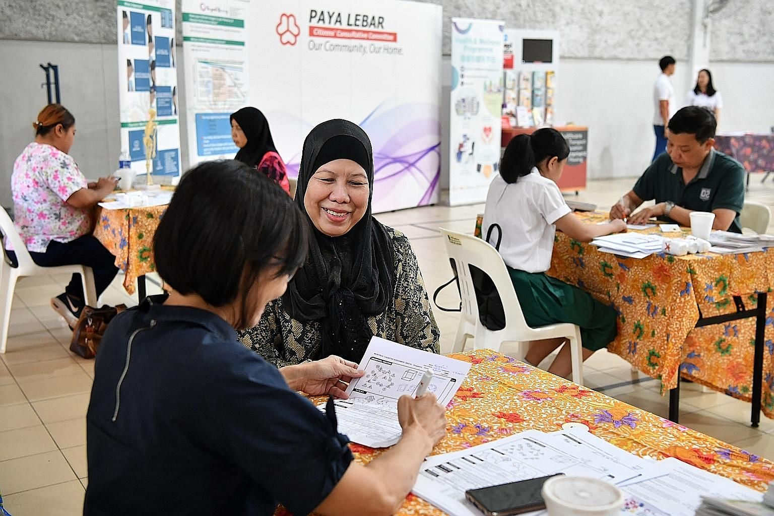 Residents (right) testing for cognitive impairment at Paya Lebar Kovan Community Club as part of the health and wellness programme yesterday. The programme is an initiative by Aljunied GRC Grassroots Organisation (Paya Lebar) and its adviser Alex Yeo