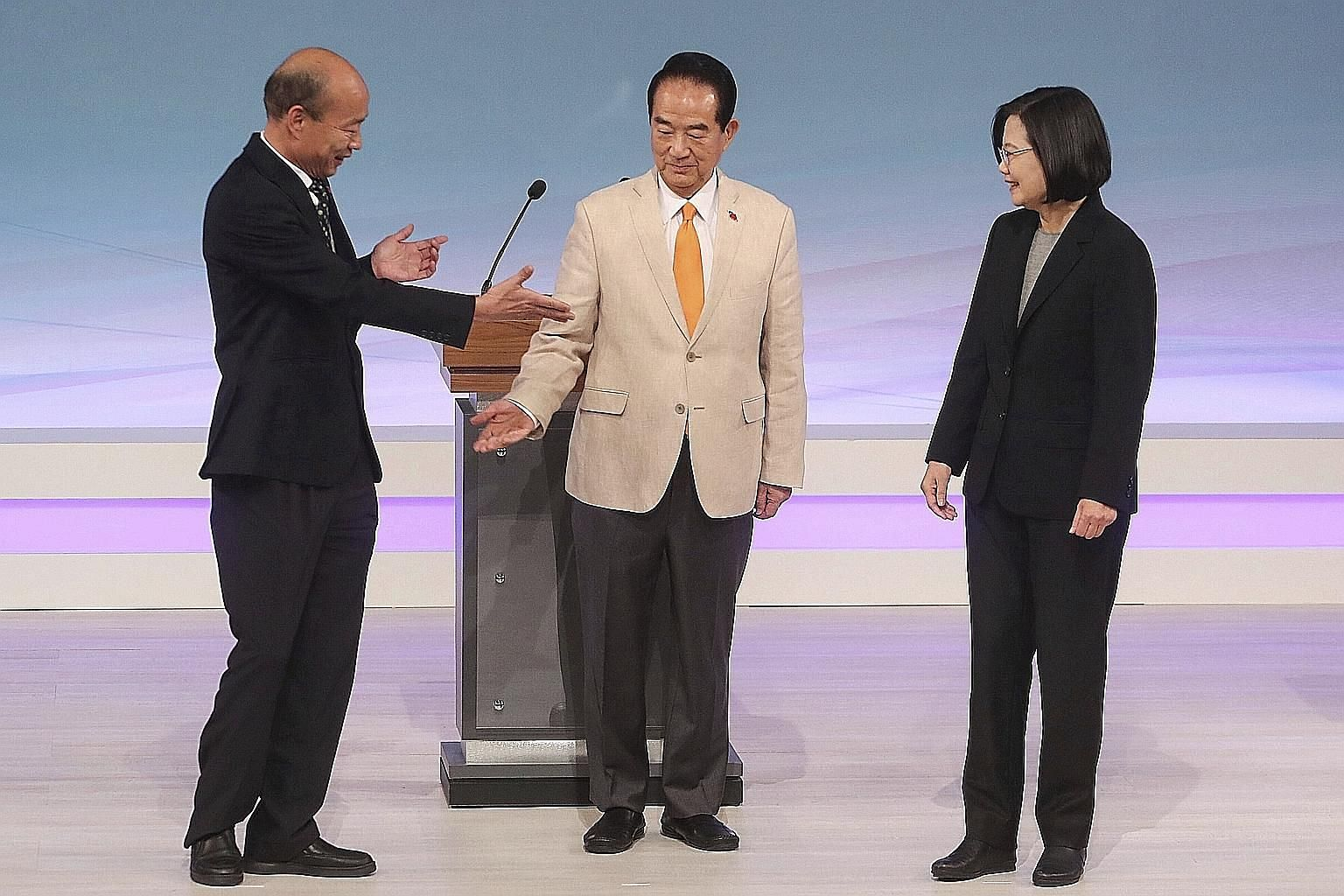 From left: Mr Han Kuo-yu from the Kuomintang, People First Party chairman James Soong and President Tsai Ing-wen of the Democratic Progressive Party before the start of their televised debate in Taipei yesterday. Taiwan will hold its general election