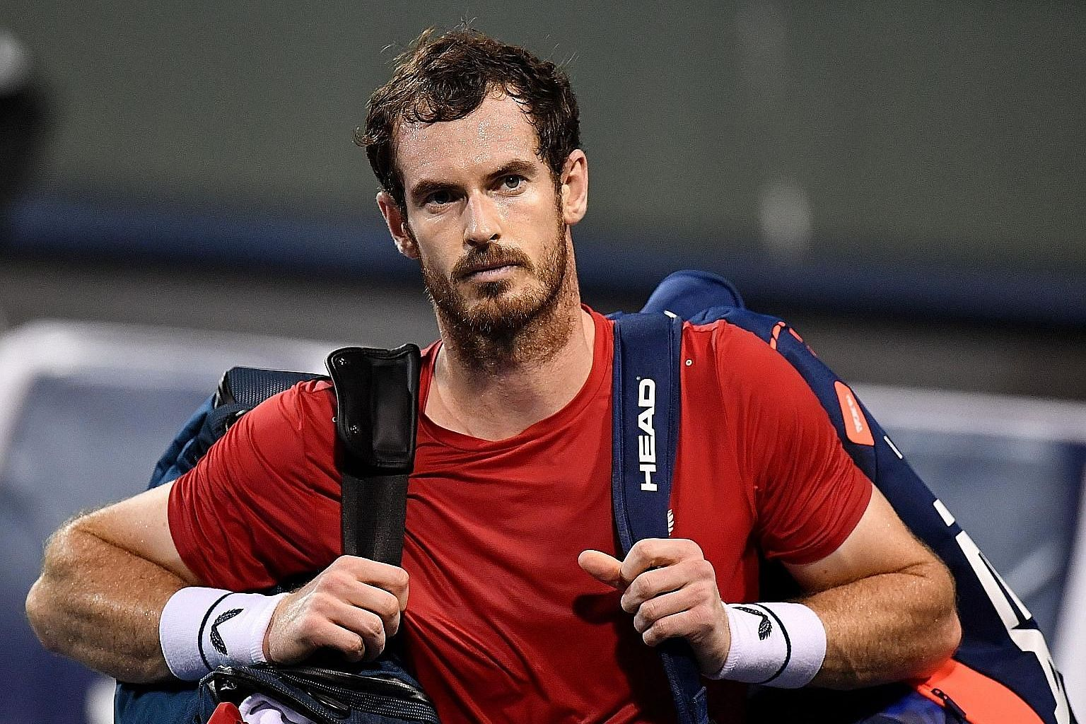 Andy Murray after losing to Fabio Fognini in the last 32 of the Shanghai Masters in October. He injured his pelvis playing for Britain in the Davis Cup last month.