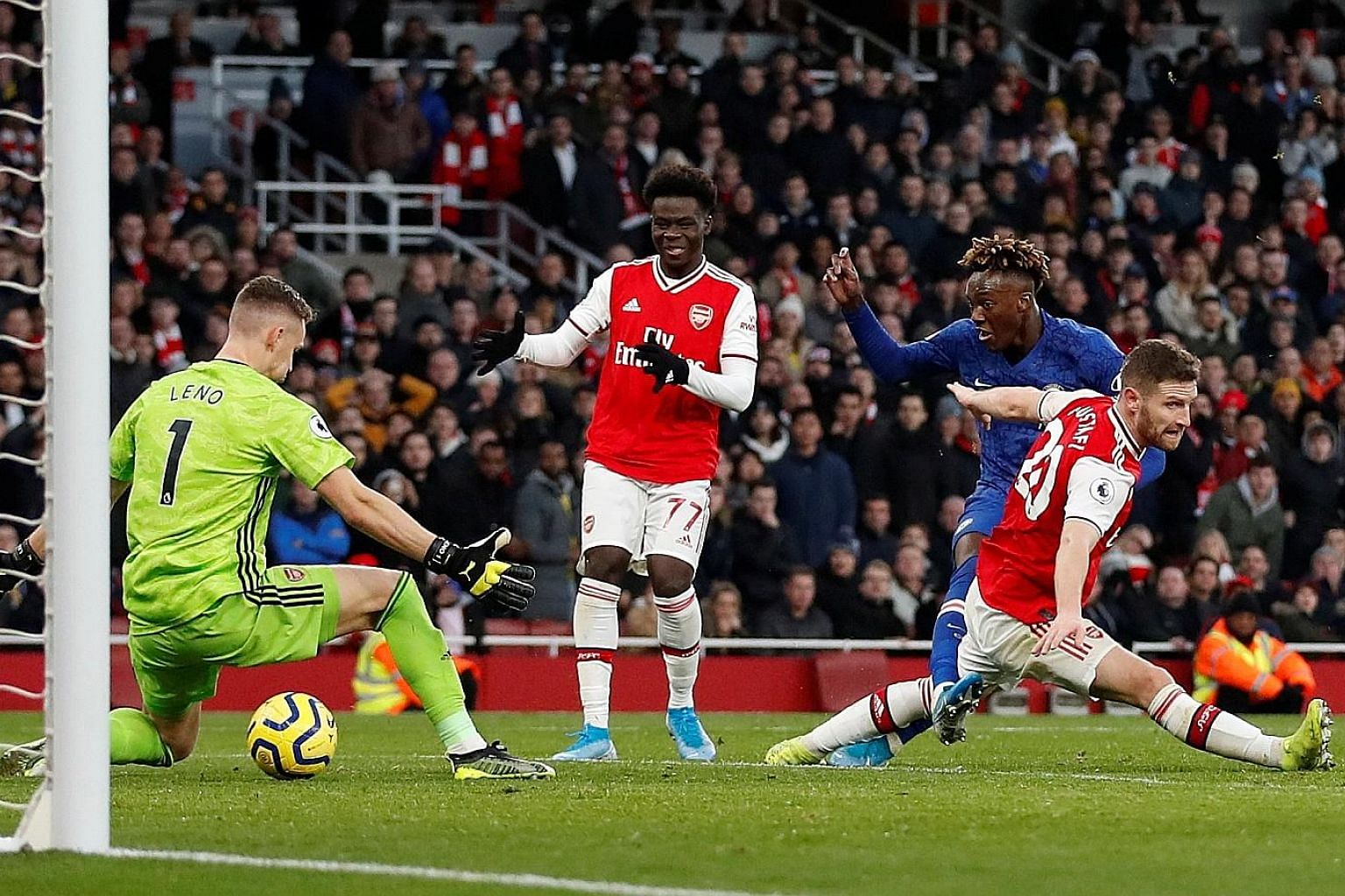 Tammy Abraham shooting through the legs of Arsenal goalkeeper Bernd Leno to complete Chelsea's comeback and earn the visiting team a 2-1 win at the Emirates. The Blues had trailed at half-time to Pierre-Emerick Aubameyang's opener.