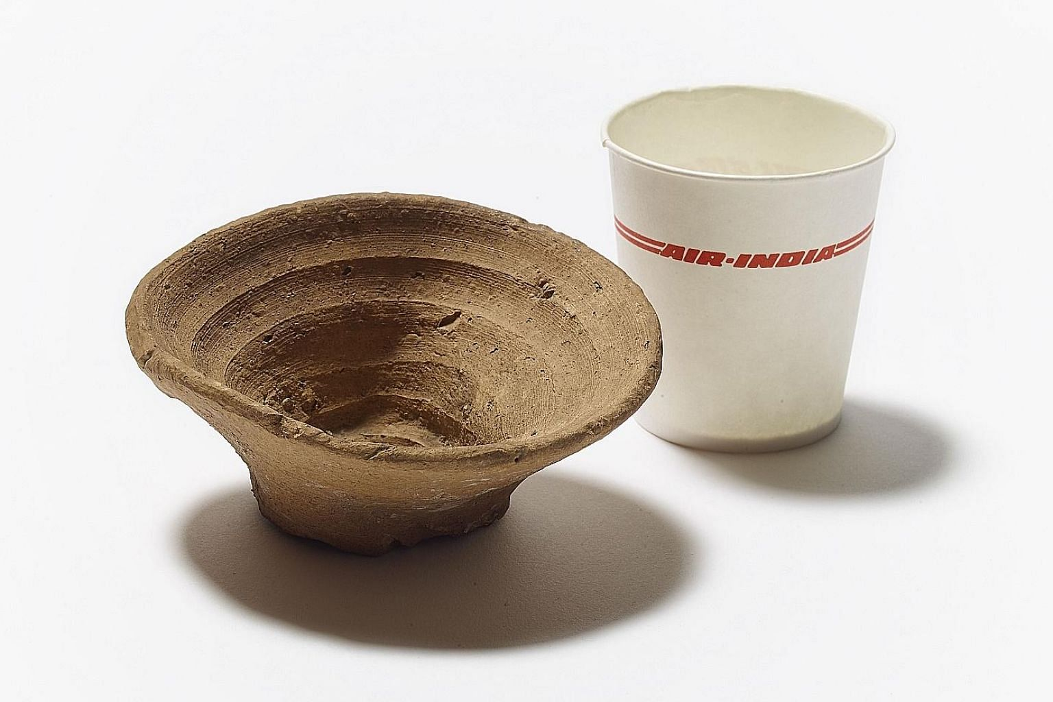 A 3,500-year-old Minoan disposable cup is shown next to a modern-day paper one.