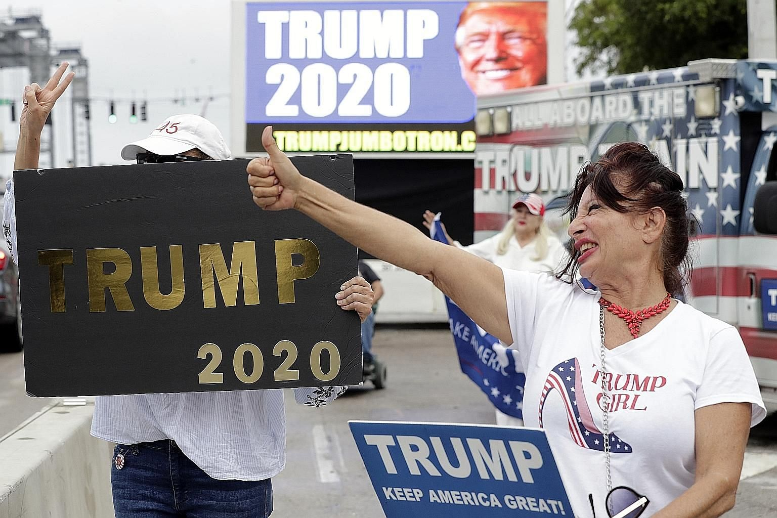 A supporter giving the thumbs-up while waiting for the motorcade carrying President Donald Trump to Mar-a-Largo, Florida, on Monday. Mr Trump is riding high in the polls, with supporters of the view that he has delivered on a host of high-profile iss