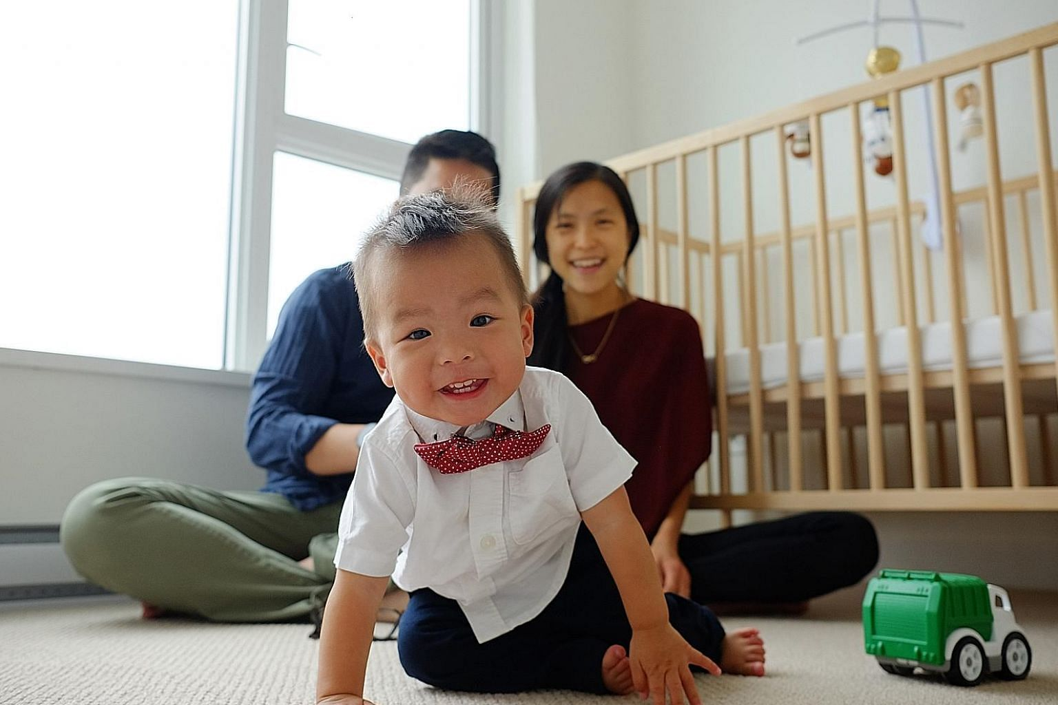Singaporean couple Stanley Lai and Cheryln Lai, who are Canadian permanent residents, said it felt natural for their son Jonah to be Singaporean as well as Canadian.