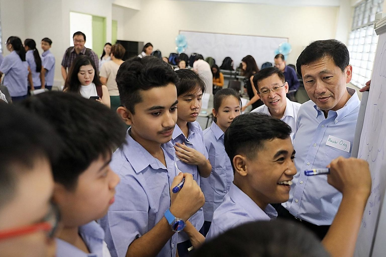 Above: Education Minister Ong Ye Kung visiting a Secondary 1 form class with students from different streams at Ping Yi Secondary School yesterday. Below, from left: Ping Yi Sec 1 student Zayeed Ibrahim, who is in a form class with students from othe