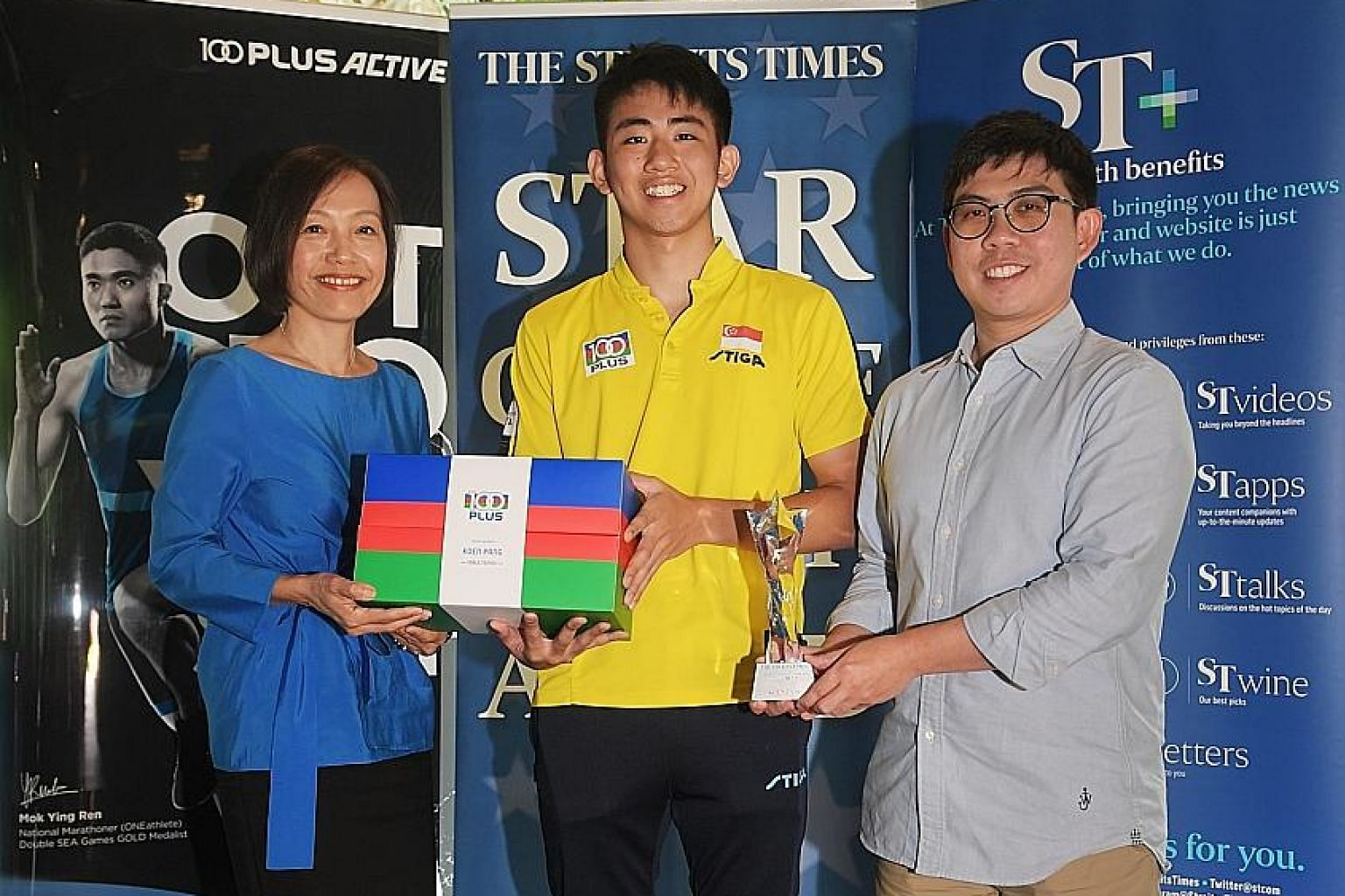 The Straits Times Star of the Month award winner for December Koen Pang with Jennifer See, managing director of F&N Foods, and Jonathan Wong, The Straits Times assistant sports editor, yesterday. ST